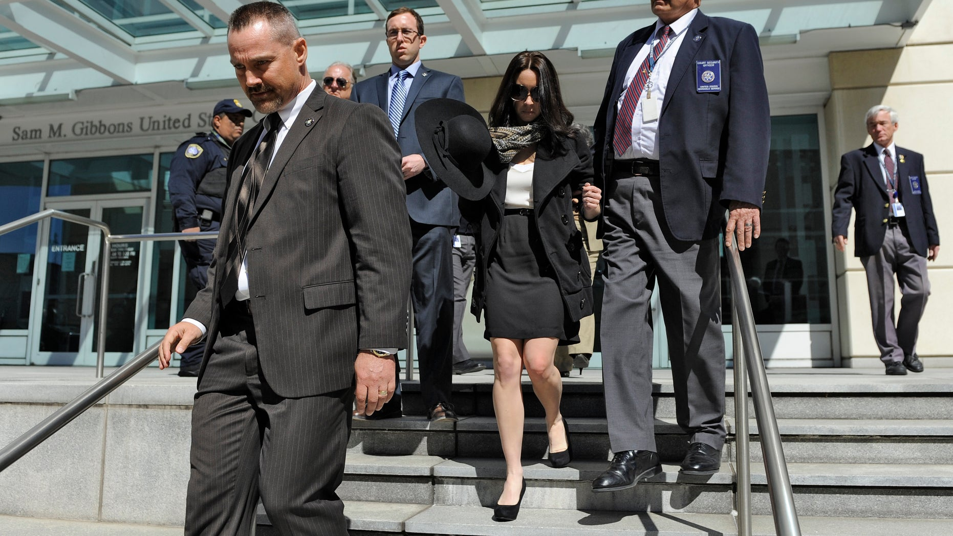 March 4, 2013: Casey Anthony, center, leaves the United States Courthouse in Tampa, Fla., with U.S. Marshals after a bankruptcy hearing in Tampa, Fla. Anthony has not made any public appearances since she left jail after being acquitted in 2011 for the murder of her two-year-old daughter Caylee.