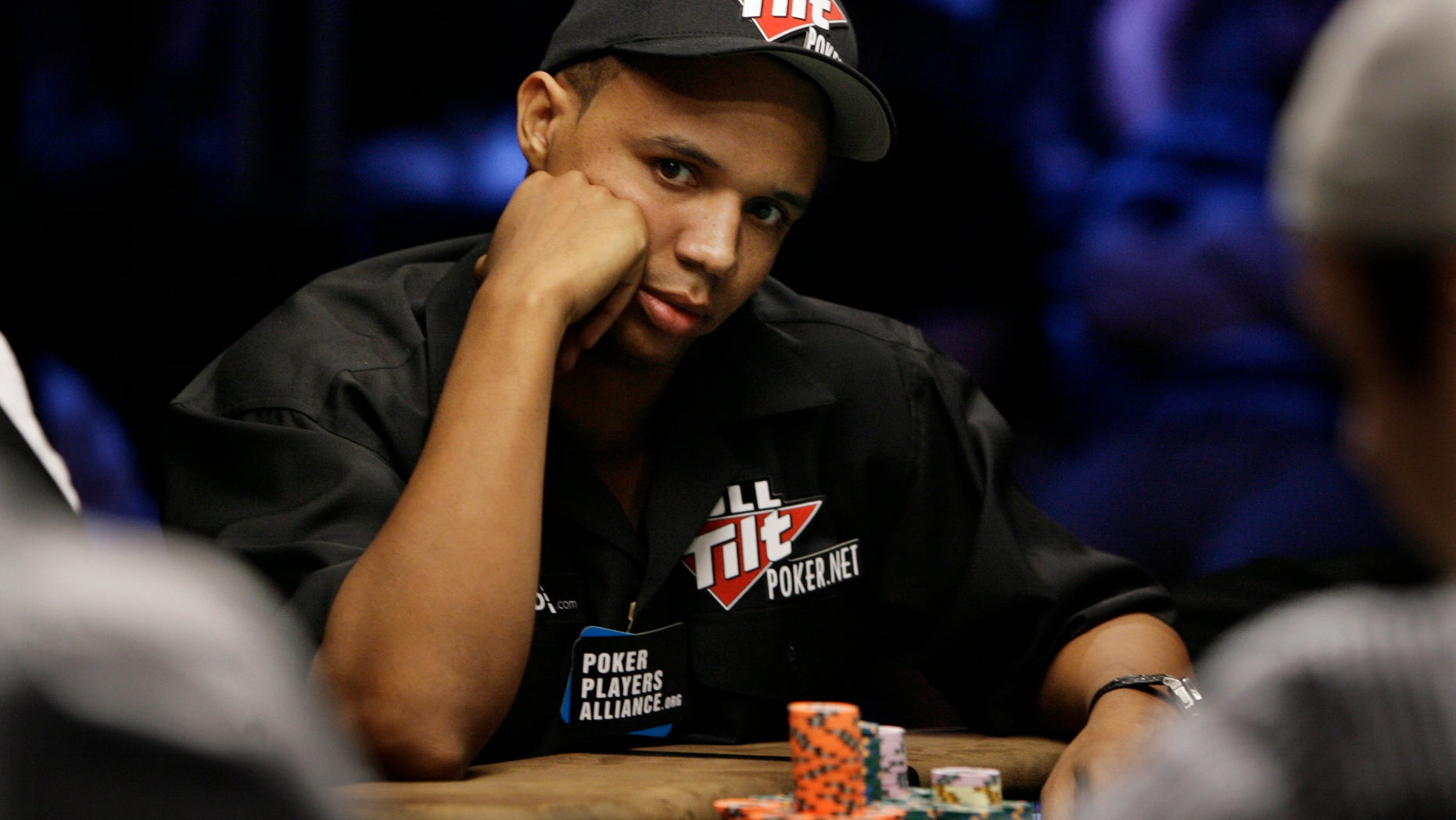 In this July 15, 2009 file photo, Phil Ivey looks up during the World Series of Poker at the Rio Hotel and Casino in Las Vegas.