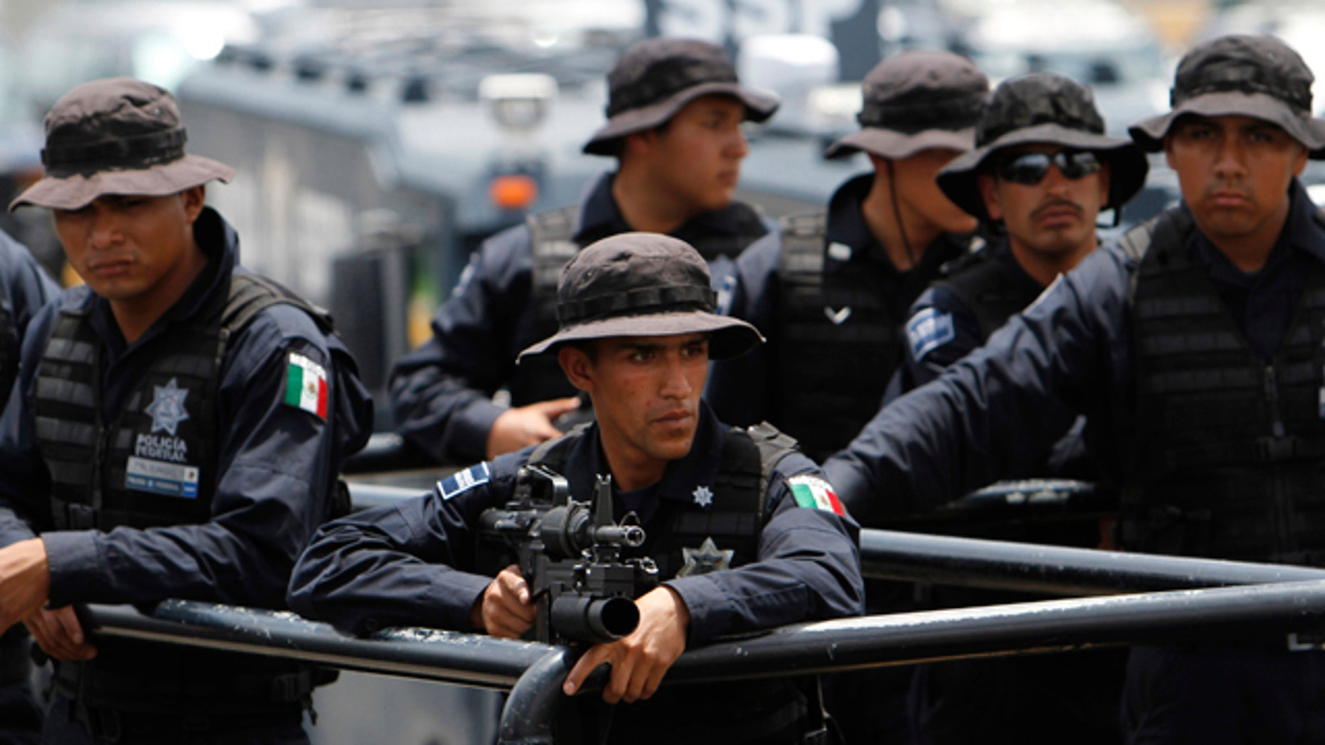 Aug. 27: Federal policemen form part of a caravan en route to Monterrey, at the federal police center in Mexico City.