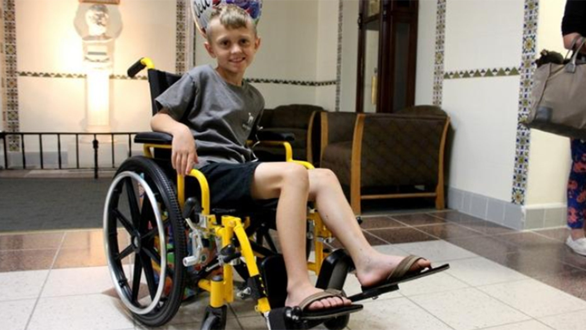 Casson Thomas leaving the hospital on Friday.