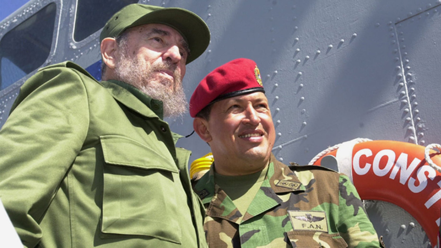 Cuban President Fidel Castro (L) and Venezuelan President Hugo Chavez travel onboard a Venezuelan Navy vessel from Porlamar to Pampatar prior a ceremony to promulgate a new Fishing Law, December 11, 2001 at Margarita Island, Venezuela. Castro is in Panpatar to attend the two-day meeting of the Association of Caribbean States (ACS). (Photo by Miraflores/Getty Images)