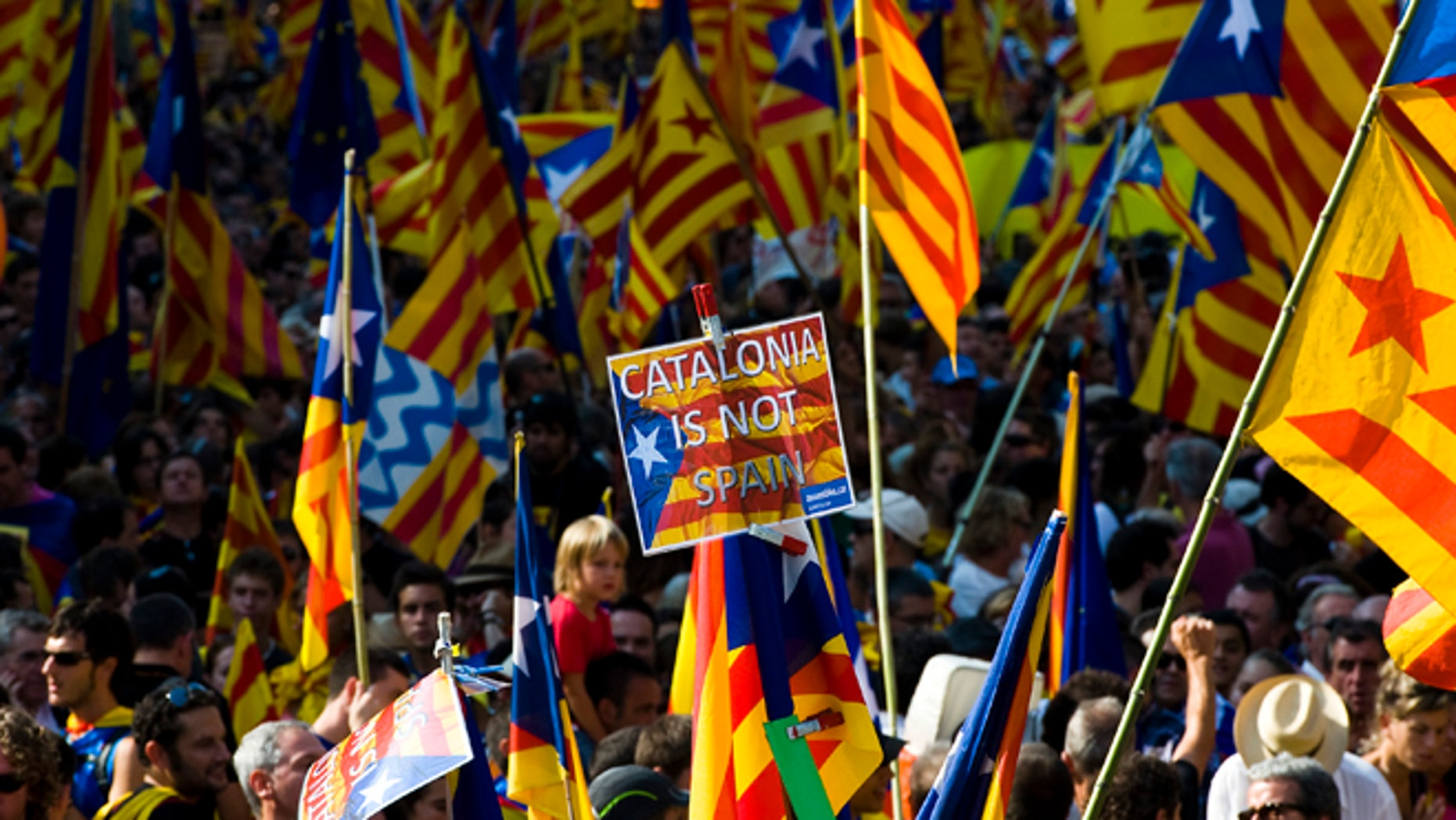 BARCELONA, SPAIN - SEPTEMBER 11:  People hold Pro-independence Catalan flags in a demonstration calling for independence during the Catalonia's National Day on September 11, 2012 in Barcelona, Spain. Thousands of Catalans took to the streets of Barcelona demanding a split from Spain and control of their own economy under the slogan 'Catalonia: New European State' on Catalonia's National Day. The Diada Nacional is held every September 11 to remember the defeat of the Catalan troops in 1714.  (Photo by David Ramos/Getty Images)