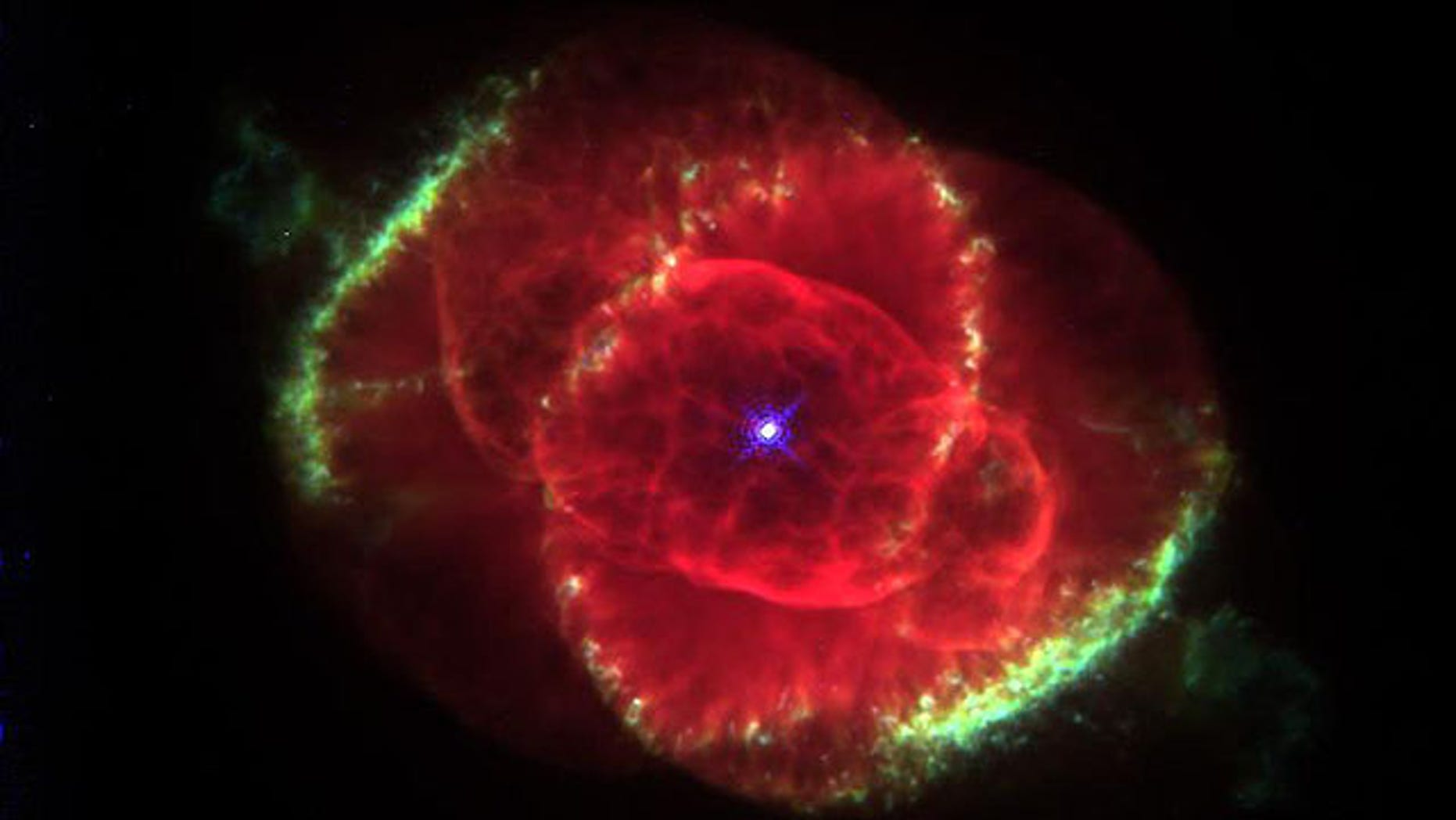 Three thousand light-years away, a dying star throws off shells of glowing gas in this image from the Hubble Space Telescope of the Cat's Eye Nebula.