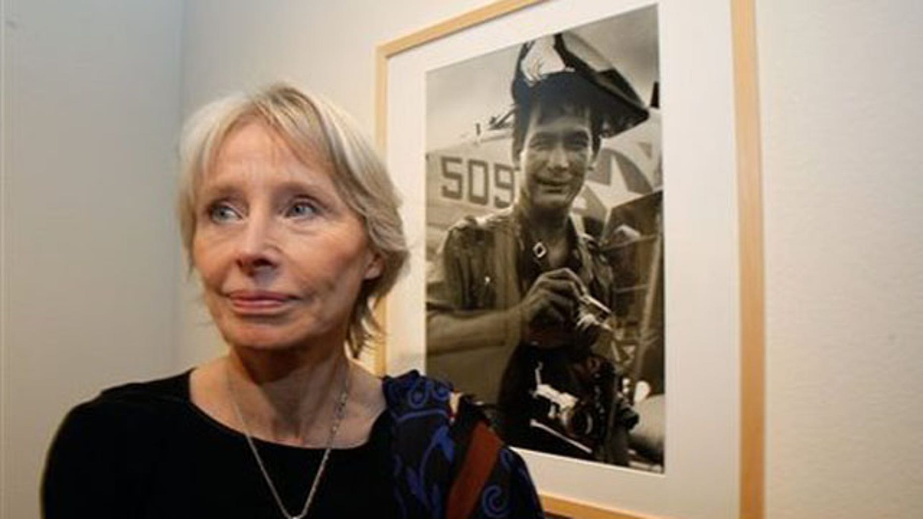Feb. 8, 2011: Cecile Blumental, nee Schrouben, friend of Henri Huet, stands next to a photograph of Huet at the 'Henri Huet, Vietnam' exhibition at the Maison Europeenne de la Photographie, MEP, in Paris.