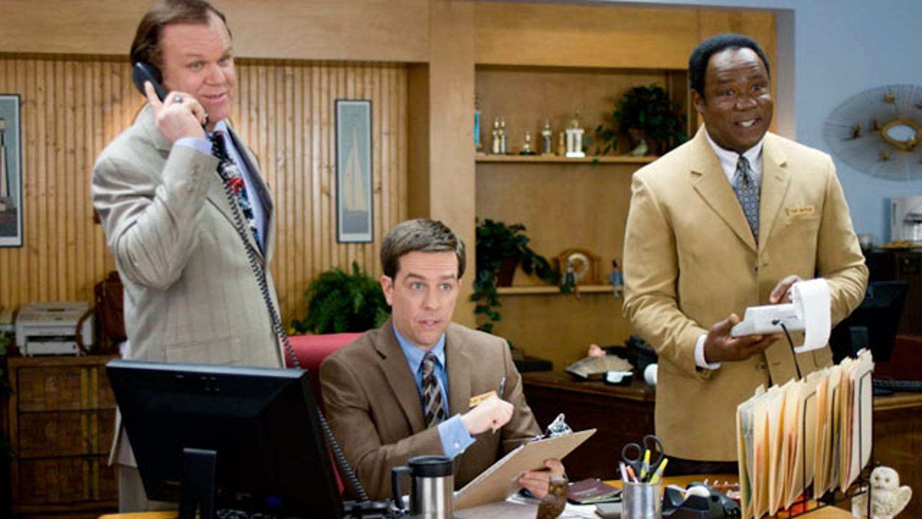 """In this film publicity image released by Fox Searchlight Films, from left, John C. Reilly, Ed Helms and Isiah Whitlock Jr. are shown in a scene from, """"Cedar Rapids."""" (AP)"""