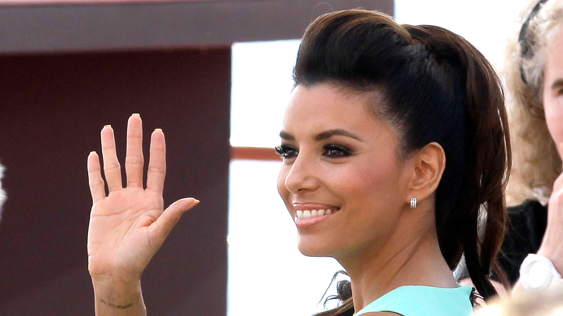 June 13, 2012:  In this file photo, actress Eva Longoria waves to the fans during the 2012 Monte Carlo Television Festival in Monaco.