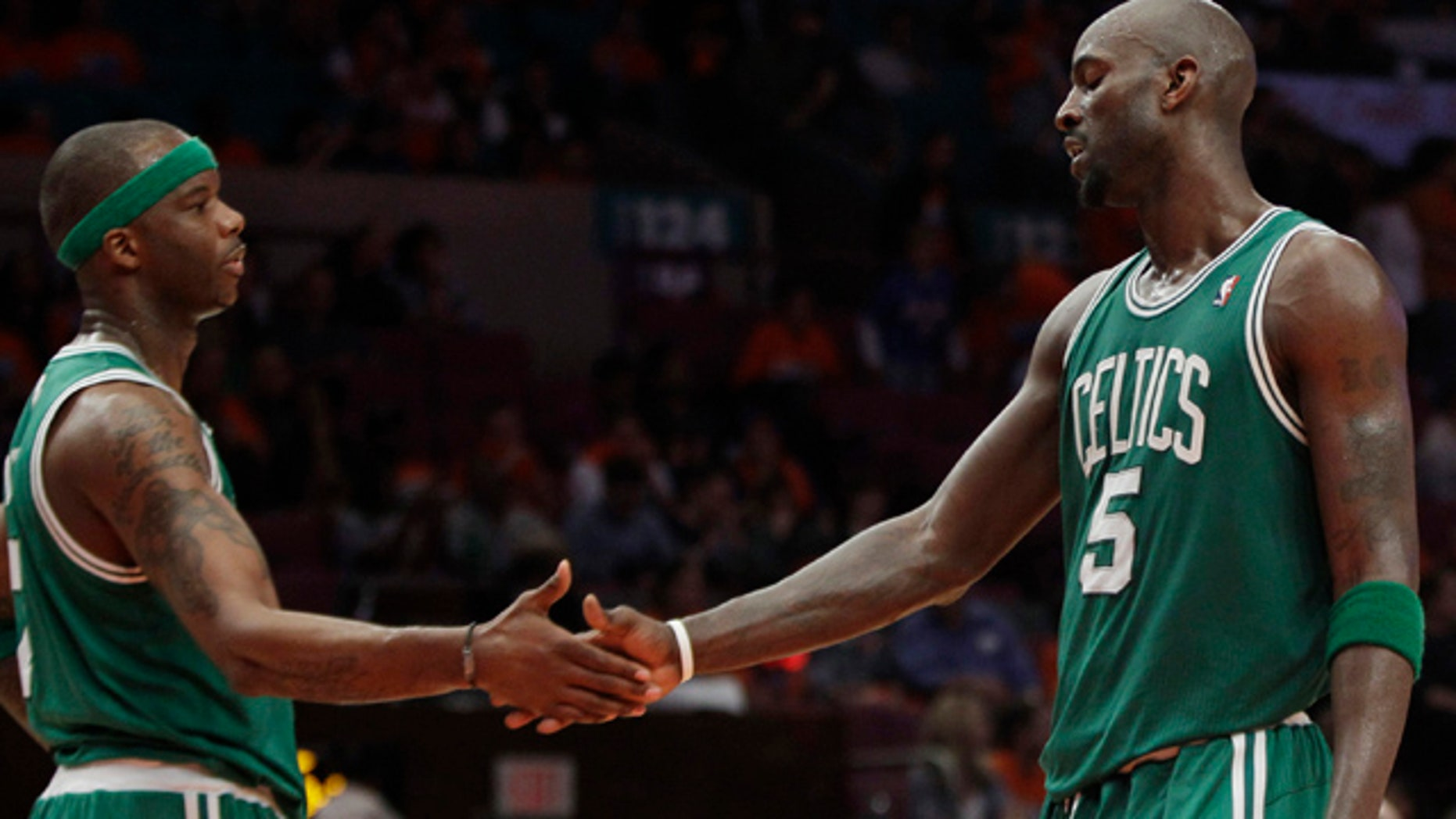 April 24, 2011: Boston Celtics forward Kevin Garnett (5) shakes hands with Jermaine O'Neal after the Celtics defeated the New York Knicks 101-89 in Game 4 of a first-round NBA basketball playoff series at Madison Square Garden in New York.