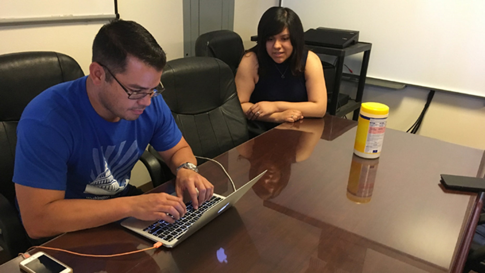 In this Wednesday, June 22, 2016 photo, Jesus Villarreal and Martha Guzman of the LULAC National Educational Service Centers, Inc., work on Hispanic student-related programs in the Albuquerque office, N.M. The nation's Hispanic population grew by 2.2 percent to 56.6 million, and New Mexico had the largest percentage of Latinos in the country at 48 percent, according to new information from the U.S. Census Bureau. (AP Photo/Russell Contreras)