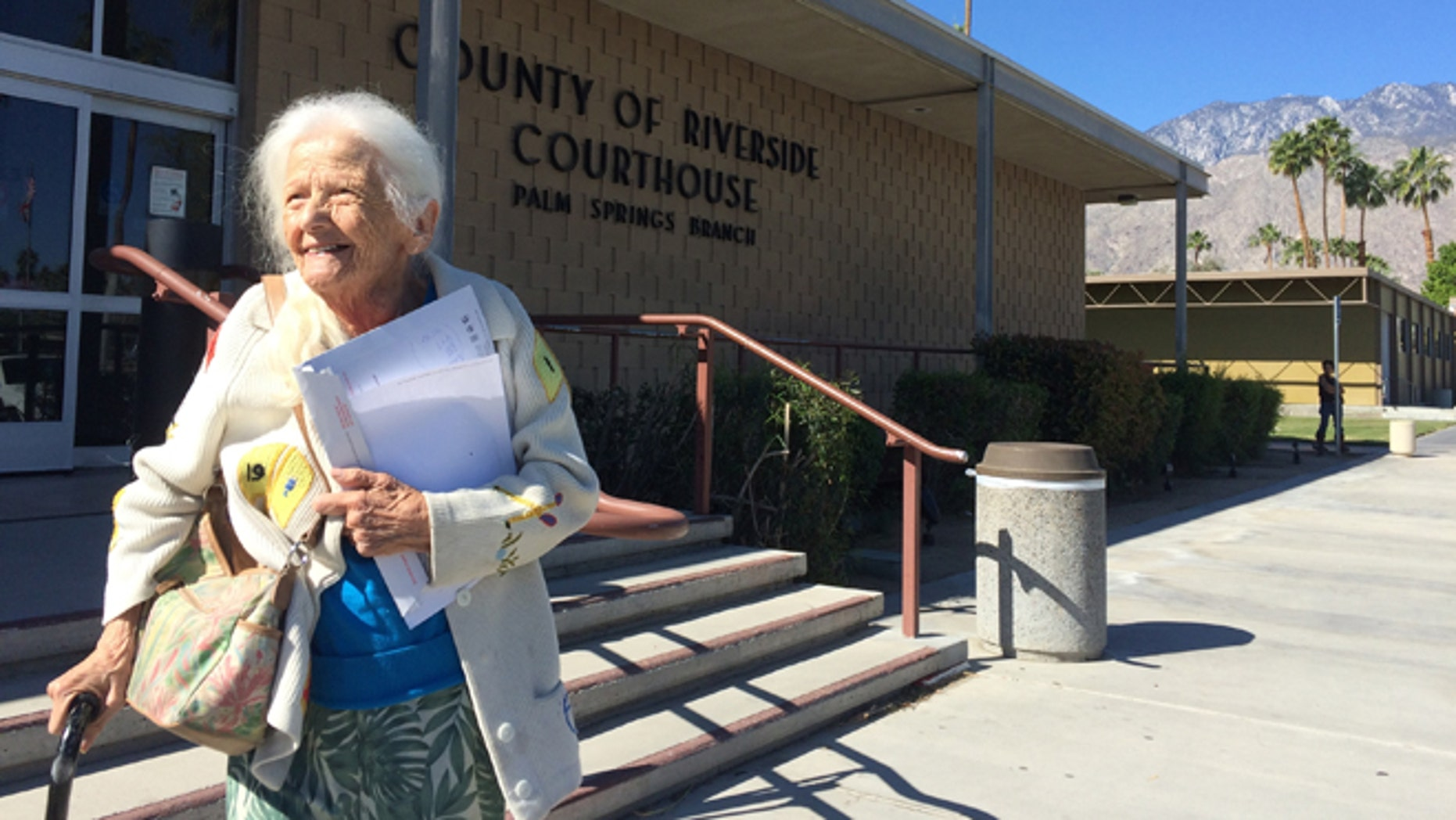This April 1, 2016 photo Evelyn Heller, who faced eviction at the age of 100, leaves the Palm Springs courthouse after losing an eviction trial. Heller, who was evicted from her apartment, has a new home in the Southern California desert after a newspaper reported on her plight and motivational speaker Tony Robbins and a local congressman joined in helping her. (Brett Kelman/Palm Springs Desert Sun via AP) RIVERSIDE PRESS-ENTERPRISE OUT; NO SALES; NO FOREIGN; MANDATORY CREDIT
