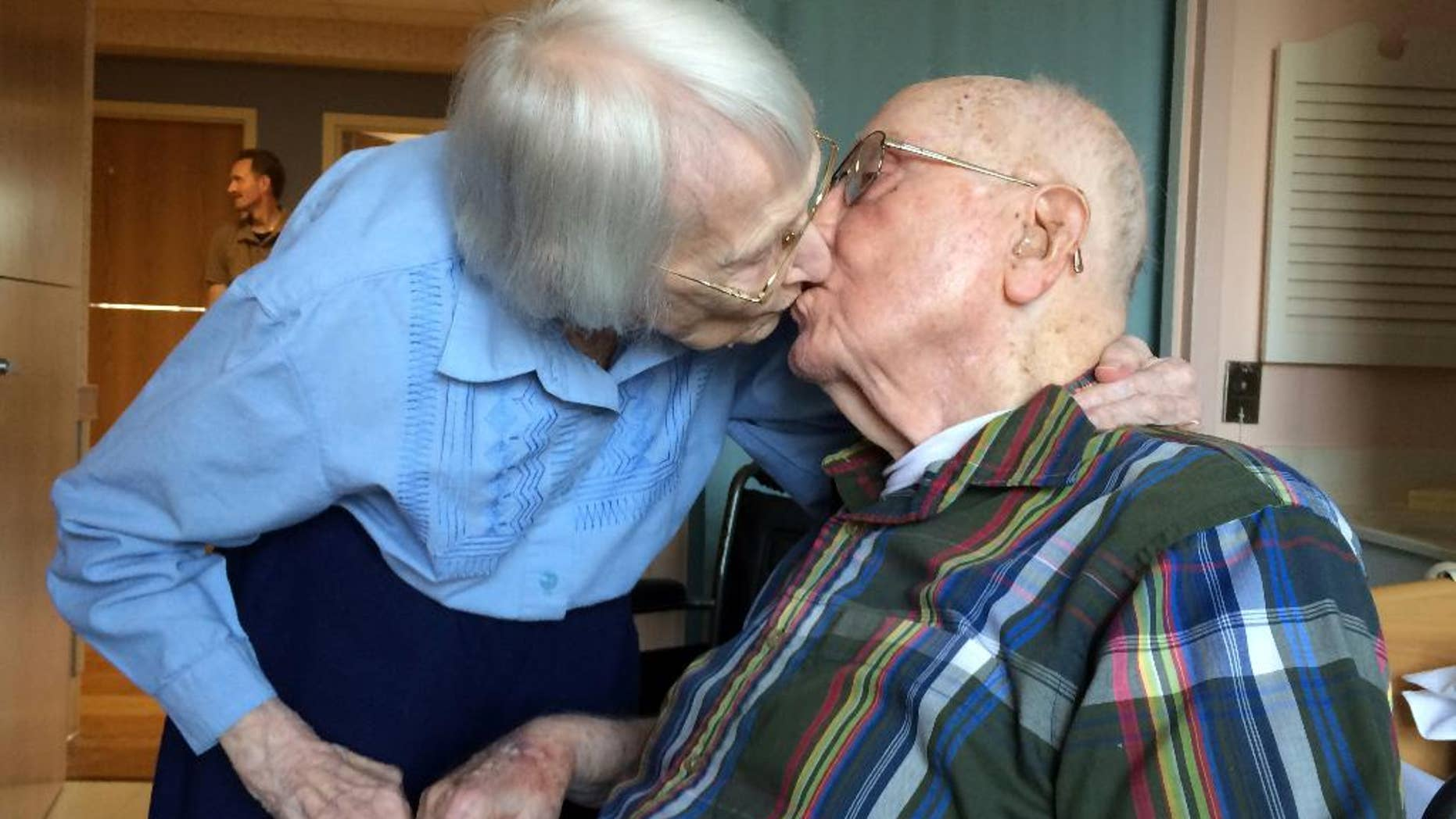 Walter and Leslie Kimmel, who are both 100 years old, enjoy a kiss as they celebrate their 75th wedding anniversary Tuesday, Aug. 18, 2015, at Charlestown Retirement Community in Catonsville, Md. The Kimmels met at Emmanuel Lutheran Church in Baltimore when they were 22 years old. Leslie played the organ and Walter sang in the choir.  (Paul J. Kessler/WBFF-TV via AP)