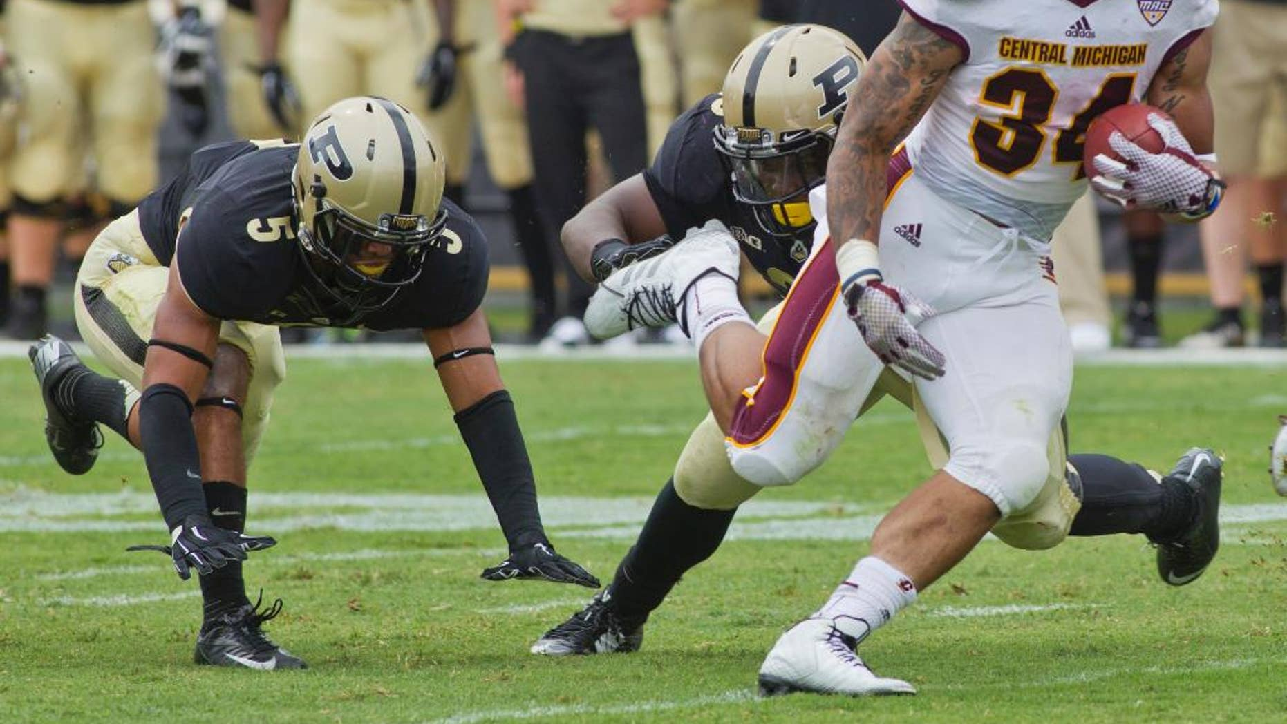 Central Michigan's Thomas Rawls eludes Purdue tacklers during an NCAA college football game  Saturday, Sept.  6, 2014, at Ross-Ade Stadium in West Lafayette. Central Michigan won 38-17. (AP Photo/Journal & Courier, Michael Heinz)