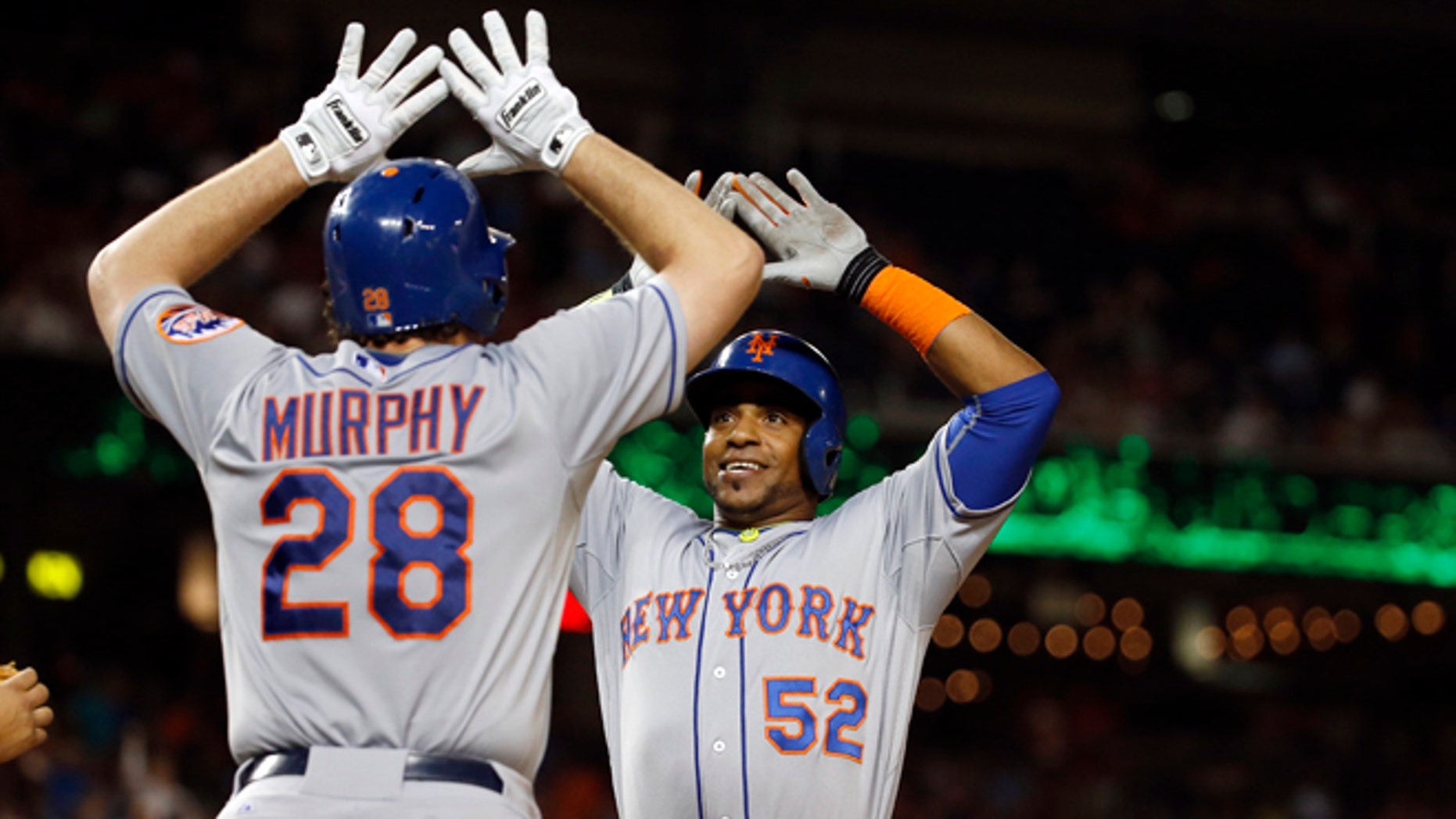 New York Mets' Daniel Murphy celebrates with Yoenis Cespedes (52) after Cespedes' two-run home run during the eighth inning of a baseball game against the Washington Nationals at Nationals Park, Wednesday, Sept. 9, 2015, in Washington. The Mets won 5-3. (AP Photo/Alex Brandon)