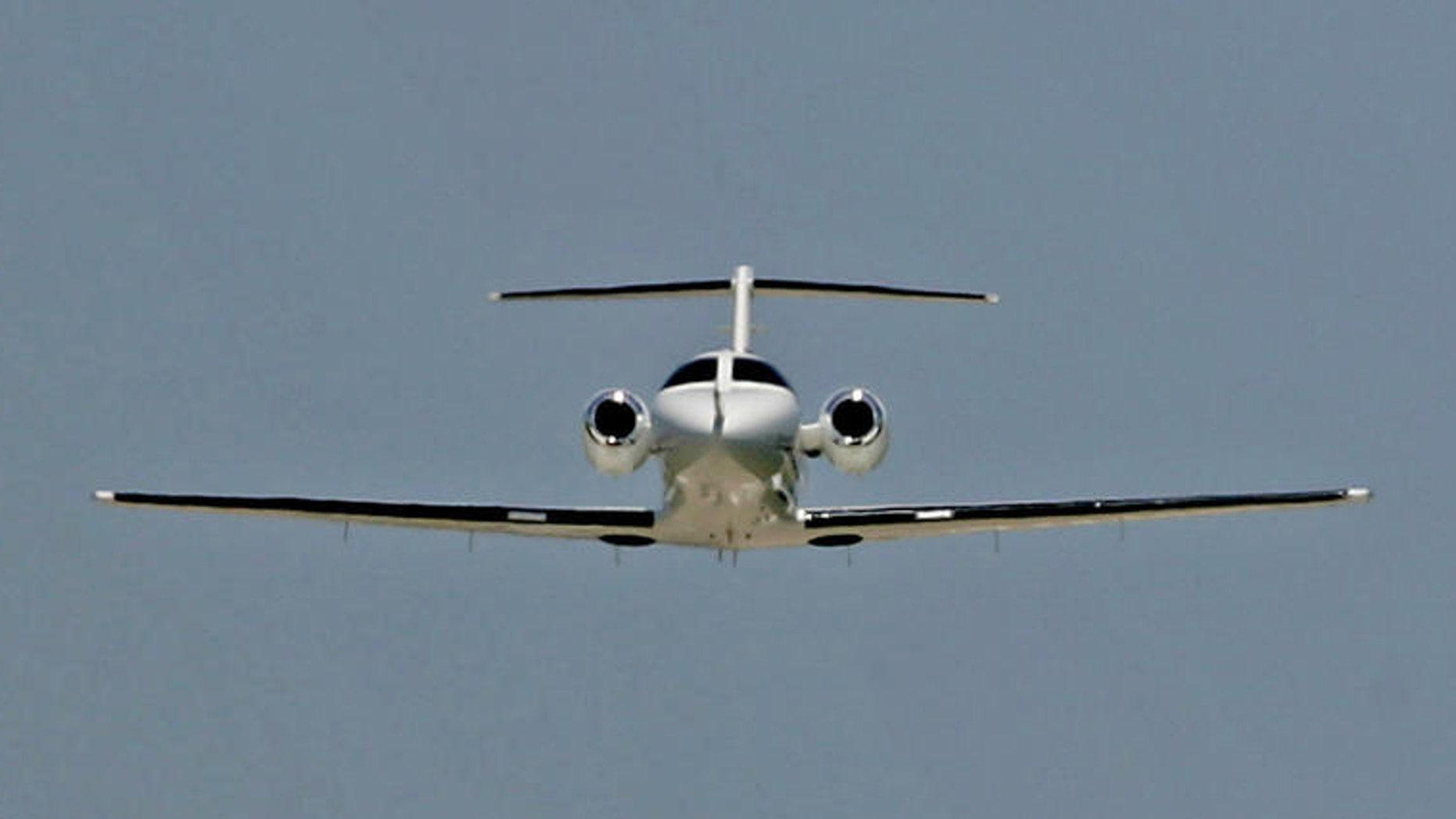 ** ADVANCE FOR WEEKEND EDITIONS, JUNE 25-26 ** A Cessna Citation Mustang business jet takes off for a test flight while a larger business jet comes in for a landing in the distance, June 15, 2005, in Wichita, Kan. Cessna has more than 200 orders for the entry-level business jet .  (AP Photo/Charlie Riedel)