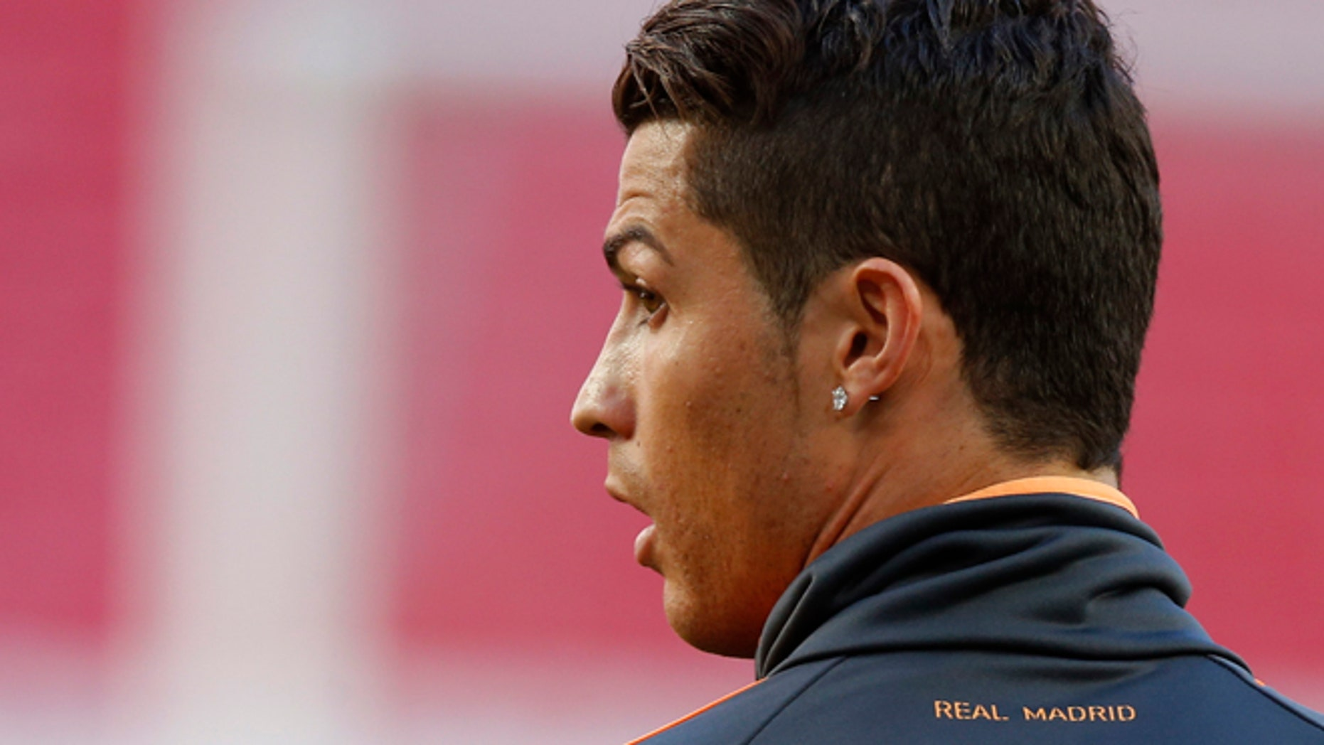 Real's Cristiano Ronaldo looks on, during a training session ahead of Saturday's Champions League final soccer match between Real Madrid and Atletico Madrid, in Luz stadium in Lisbon, Portugal, Friday, May 23, 2014. (AP Photo/Daniel Ochoa de Olza)