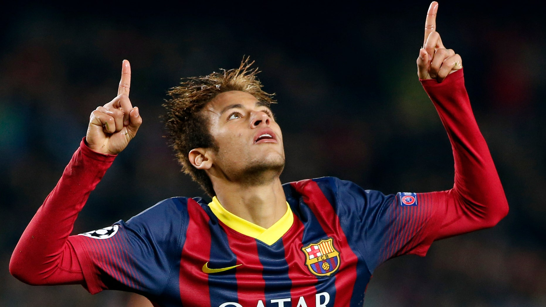 Barcelona's Neymar celebrates after scoring his side's fourth goal during a Group H Champions League soccer match between FC Barcelona and Celtic FC at the Camp Nou stadium in Barcelona, Spain, Wednesday Dec. 11, 2013.(AP Photo/Emilio Morenatti)