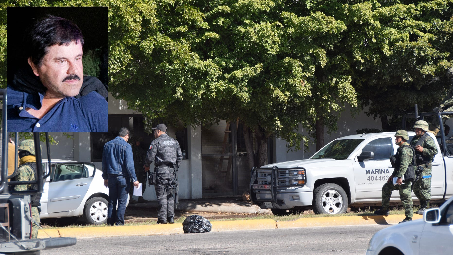 """Mexican navy marines and other law enforcement officers inspect a home after the recapture of Mexico's most wanted drug lord, Joaquin """"El Chapo"""" Guzman in the city of Los Mochis, Mexico, Friday, Jan. 8, 2016. The worldâs most-wanted drug lord was captured for a third time, as Mexican marines staged heavily-armed raids that caught Guzman six months after he escaped from a maximum security prison. (Libertad Montoya via AP/EL DEBATE)"""