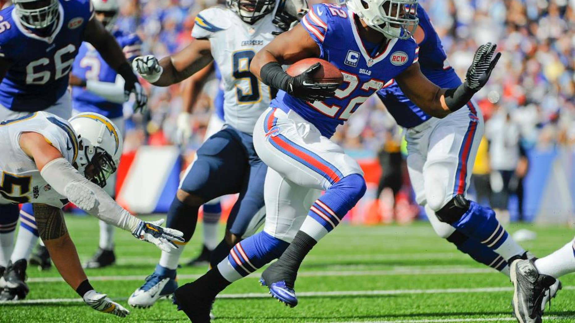 Buffalo Bills' Fred Jackson (22) rushes away from San Diego Chargers' Manti Te'o, left, for a touchdown during the second half of an NFL football game, Sunday, Sept. 21, 2014, in Orchard Park, N.Y. (AP Photo/Gary Wiepert)