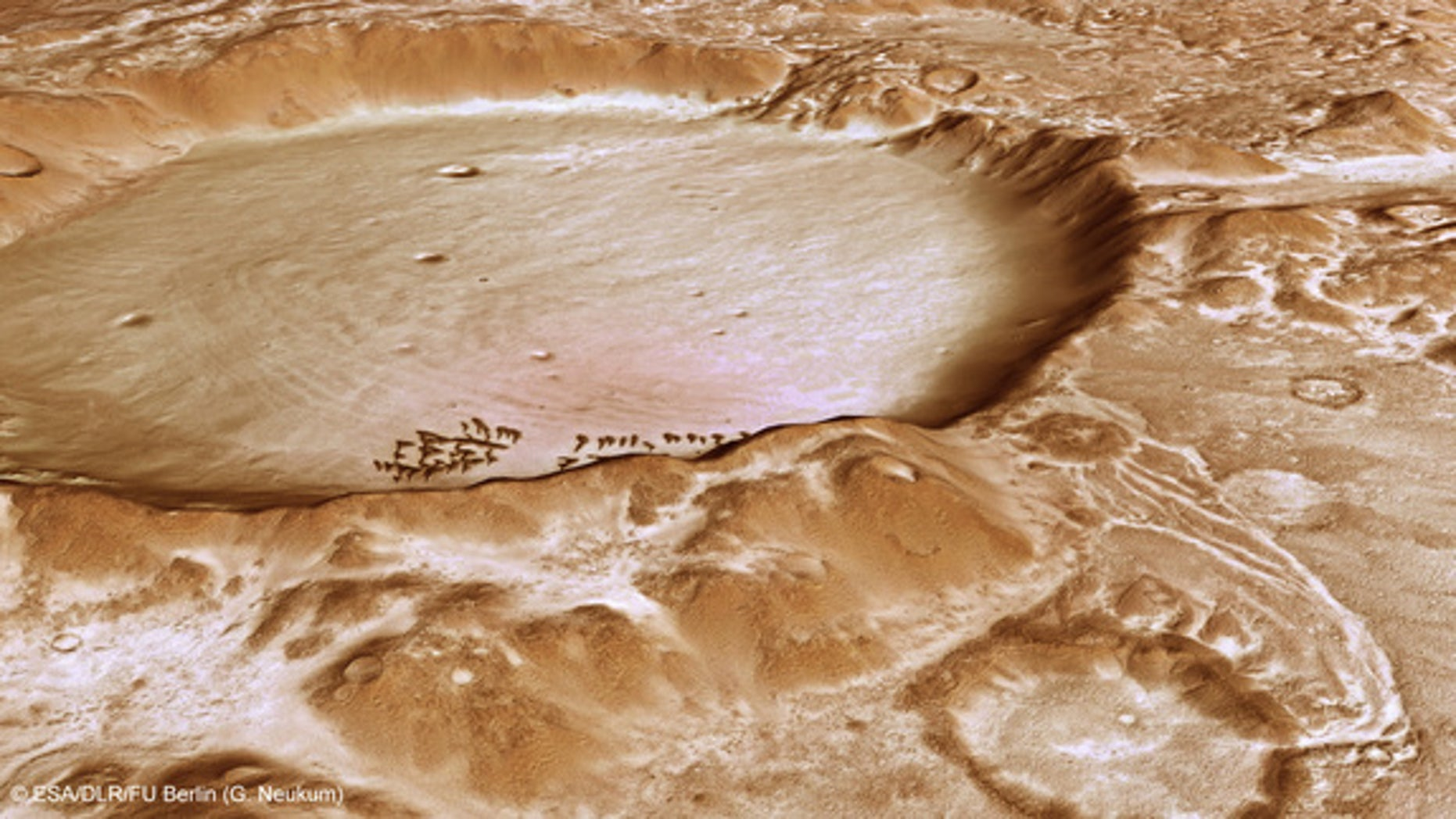 This computer-generated perspective view of Charitum Montes was created using data obtained from the High-Resolution Stereo Camera (HRSC) on ESA's Mars Express. The image shows the large breach in the northern wall of the crater, located near t