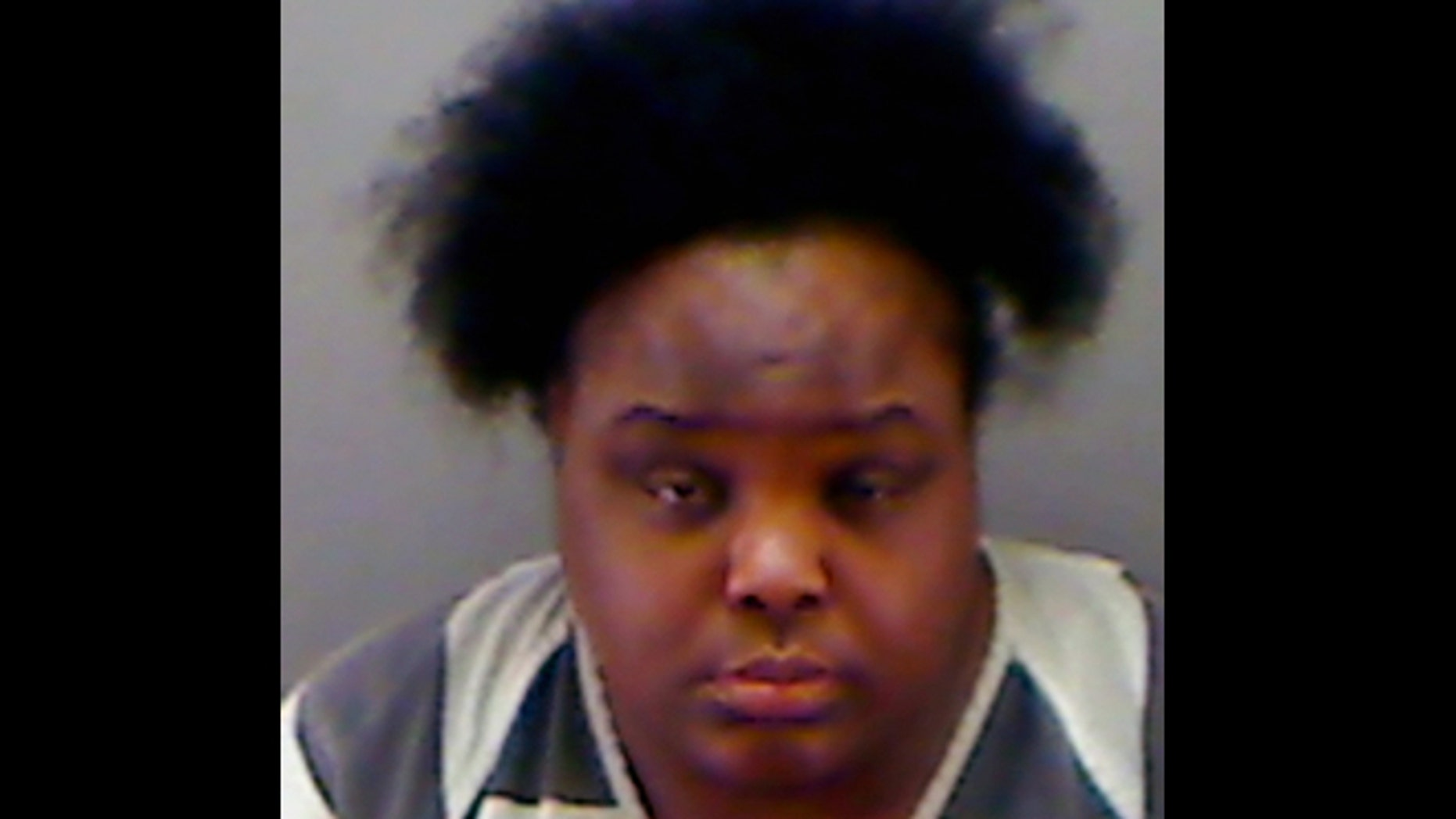 This undated booking photo provided by the Longview Police Department shows Charity Johnson. Authorities say Johnson, 34, posed as a teenager to enroll as a sophomore at a private Texas high school.