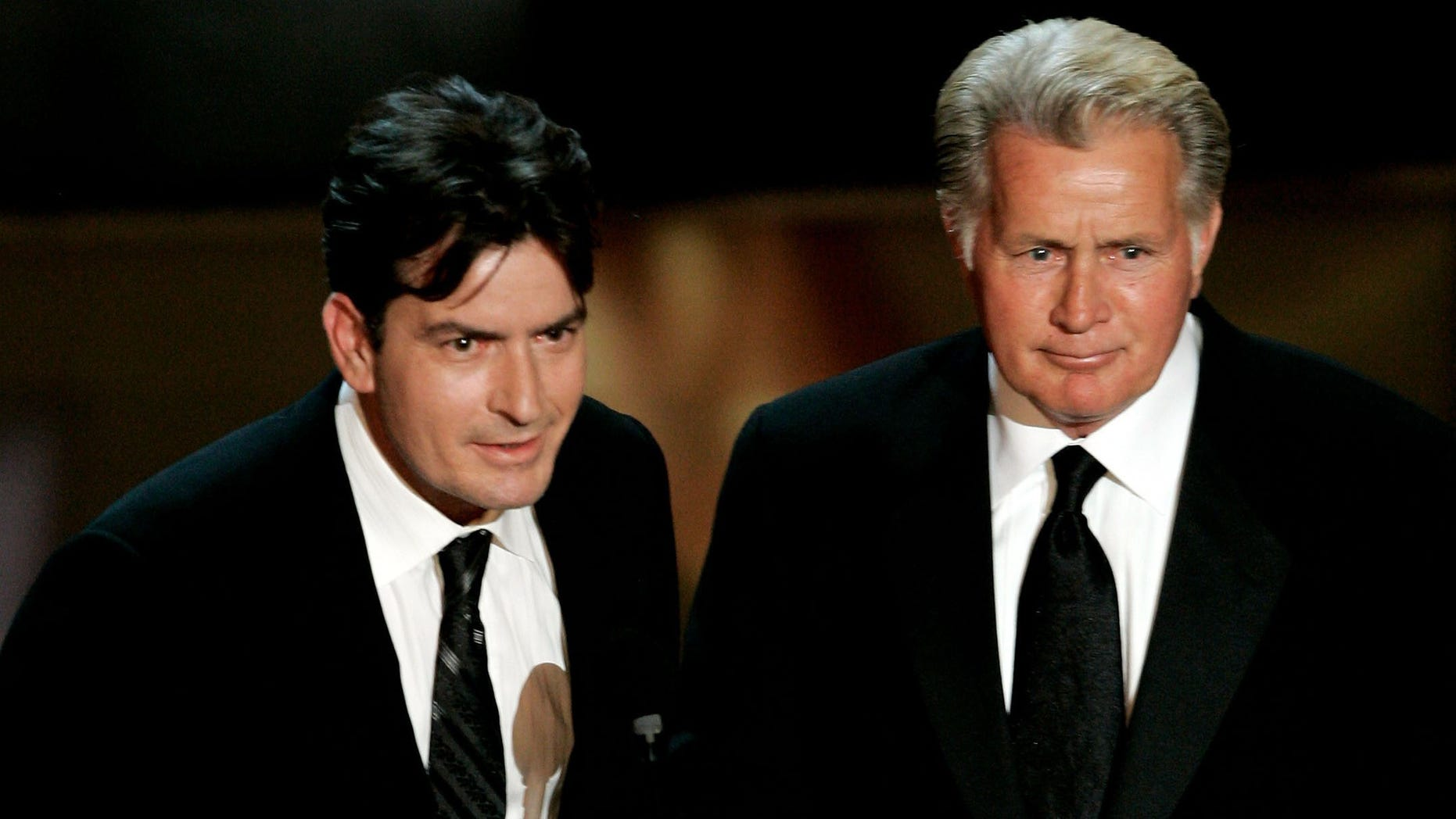 LOS ANGELES, CA - AUGUST 27:  Actors Charlie Sheen (L) and Martin Sheen present the award for Outstanding Supporting Actress in a Drama Series onstage at the 58th Annual Primetime Emmy Awards at the Shrine Auditorium on August 27, 2006 in Los Angeles, California.  (Photo by Vince Bucci/Getty Images)