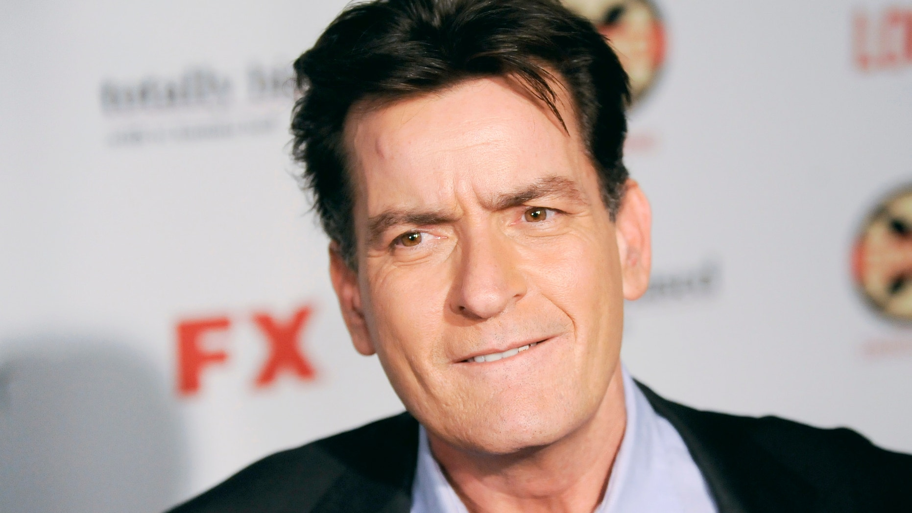 Actor Charlie Sheen arrives at the Hollywood FX Summer Comedies Party in Los Angeles, California June 26, 2012.