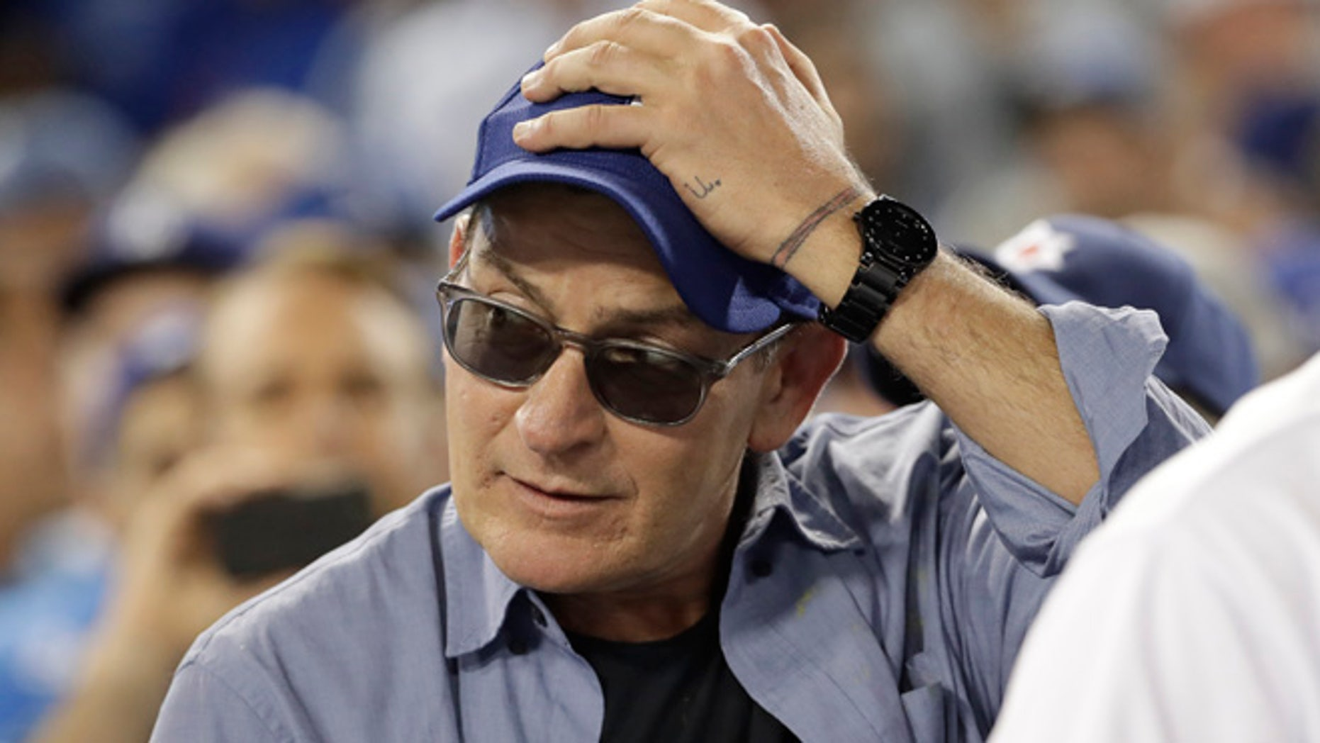 Actor Charlie Sheen reacts during the fifth inning of Game 4 of the National League baseball championship series between the Chicago Cubs and the Los Angeles Dodgers Wednesday, Oct. 19, 2016, in Los Angeles. (AP Photo/David J. Phillip)