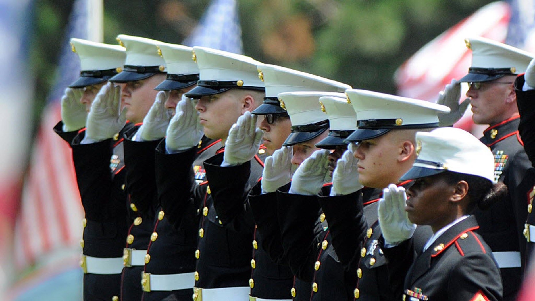 Marines give a final salute to Marine Gunnery Sgt. Thomas Sullivan during ceremony at the Massachusetts Veterans' Memorial Cemetery, Monday, July 27, 2015, in Agawam, Mass. Sullivan was one of five service members killed by a gunman in Chattanooga, Tenn. on July 16. The gunman was killed by police. (Don Tregger/The Republican via AP, Pool)