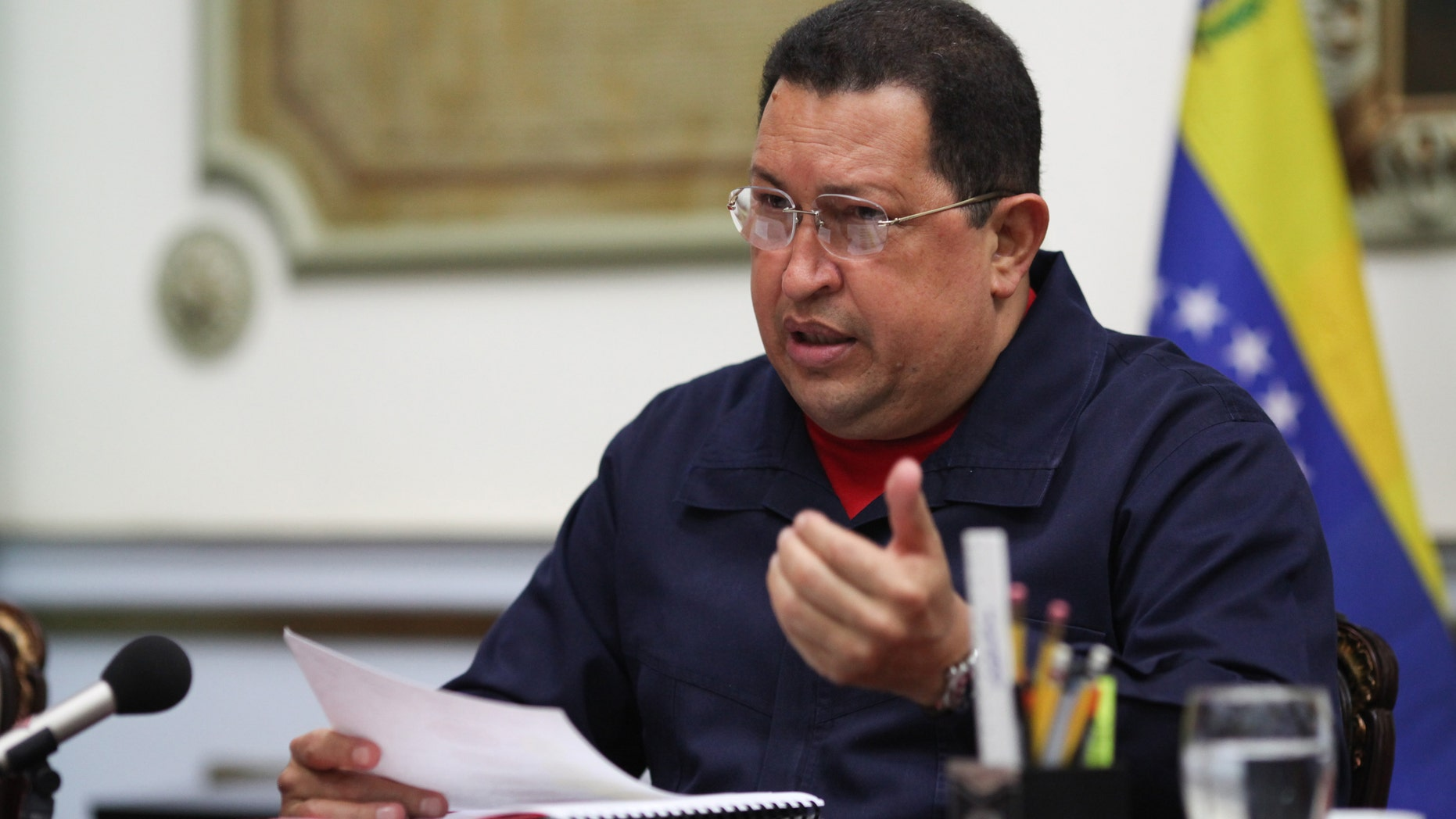 Venezuelan President Hugo Chavez, center, during a meeting with ministers, Thursday March 29, 2012.  (AP Photo/Miraflores Presidential Press Office)