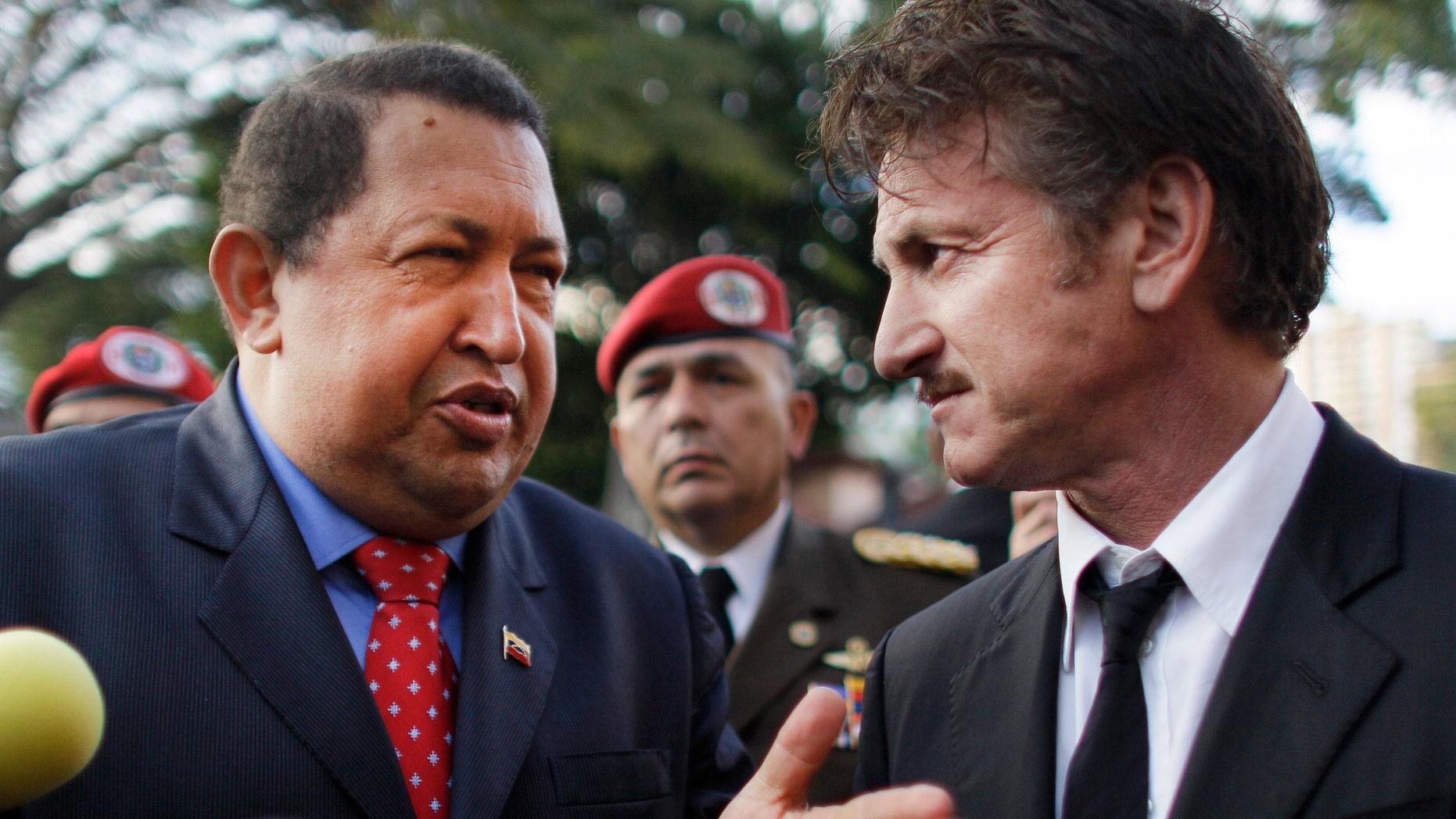 Venezuela's President Hugo Chavez, left, talks to actor Sean Penn, of United States, who visited the presidential palace in Caracas, Venezuela, Thursday, Feb. 16, 2012. (AP Photo/Ariana Cubillos)