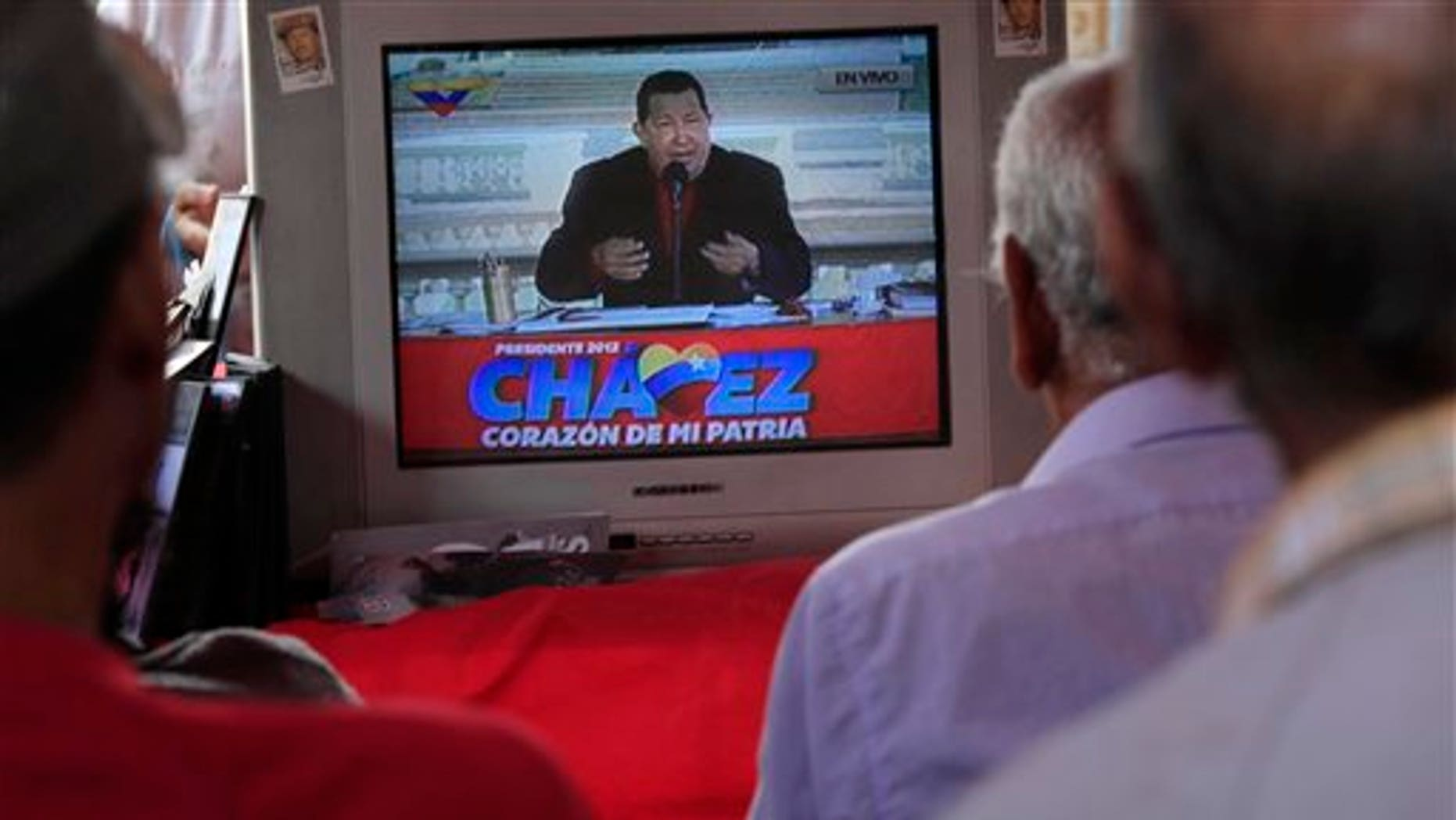 ADVANCE FOR USE SUNDAY, SEPT. 23, 2012 AND THEREAFTER - In this Sept. 5, 2012 photo, people watch a TV in Caracas, Venezuela broadcasting President Hugo Chavez delivering a speech as presidential candidate. Nearly 14 years after President Hugo Chavez took office, and despite the biggest oil bonanza in Venezuela's history, there's little outward sign of the nearly one trillion petrodollars that have flowed into the country. The populist president has used the oil wealth to buttress his support through cash handouts, state-run grocery stores and a gamut of other social programs. With more money in the economy, incomes are higher and the number of people living in poverty has fallen. Yet some experts say Chavez could have done much more to improve the country's infrastructure, boost its economy and invest in the very oil industry that keeps Venezuela afloat. (AP Photo/Ariana Cubillos)