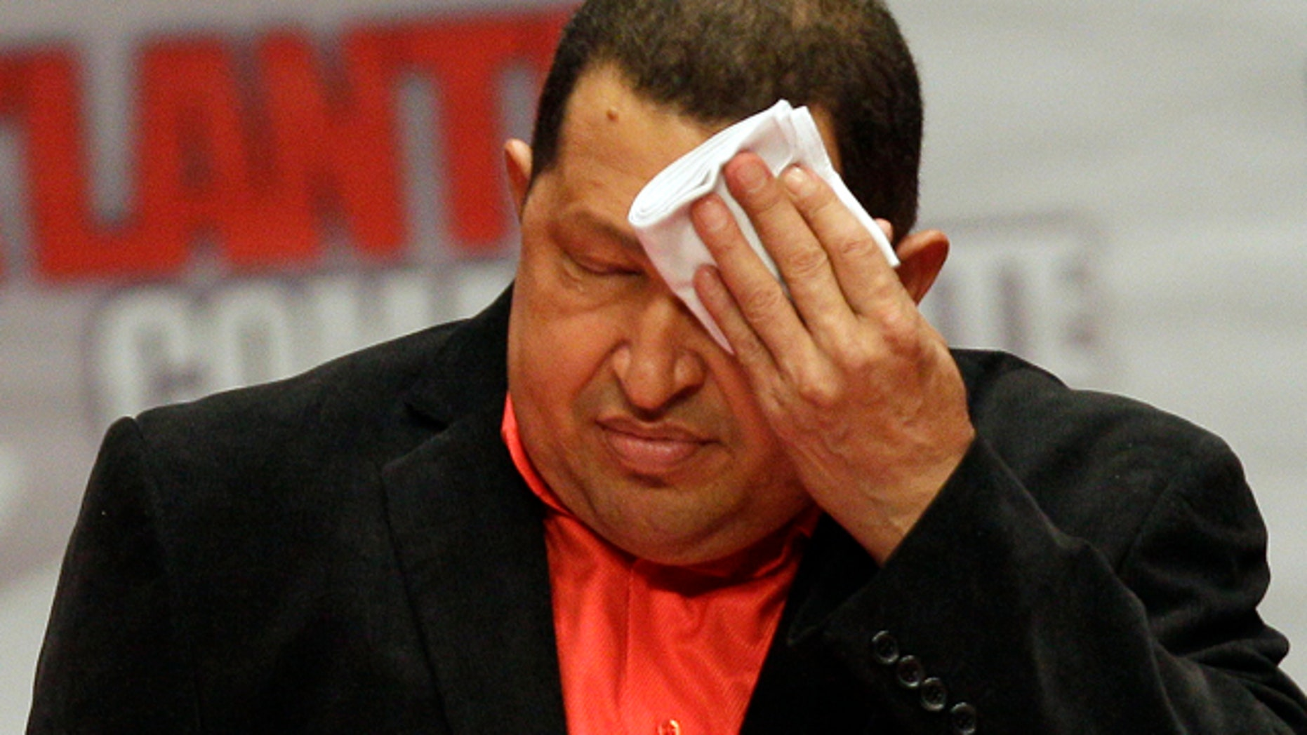 Feb. 23: President Hugo Chavez wipes his forehead as he attends a concert in his honor at the Teresa Carreno Theater in Caracas, Venezuela.