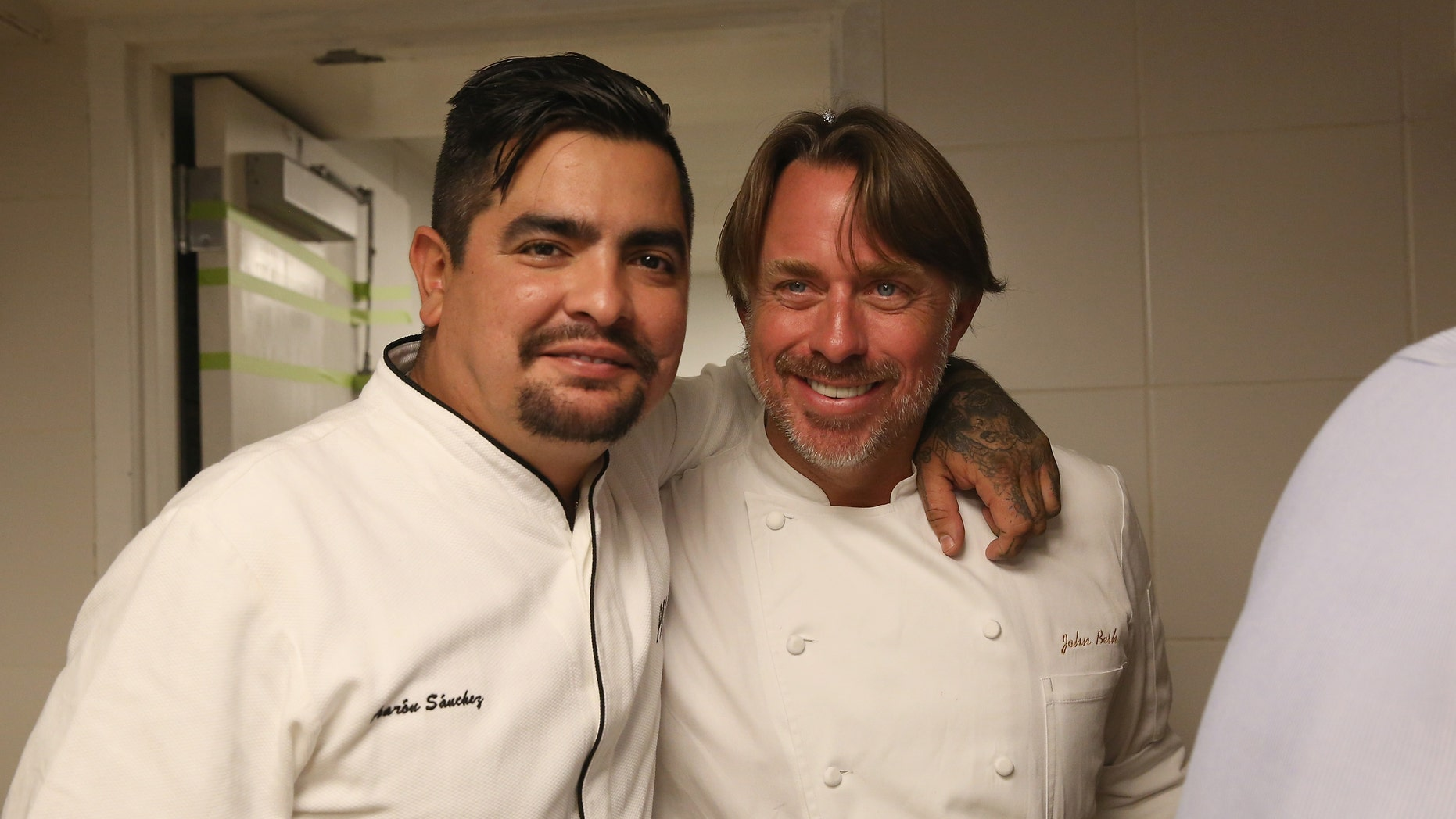 NEW YORK, NY - OCTOBER 16:  Chefs Aaron Sanchez (L) and John Besh pose at the Johnny Sanchez Dinner hosted by John Besh, Aaron Sanchez and Katy Sparks as a part of the Bank of America Dinner Series during the Food Network New York City Wine & Food Festival Presented By FOOD & WINE at Tavern On The Green on October 16, 2014 in New York City.  (Photo by Mireya Acierto/Getty Images for NYCWFF)