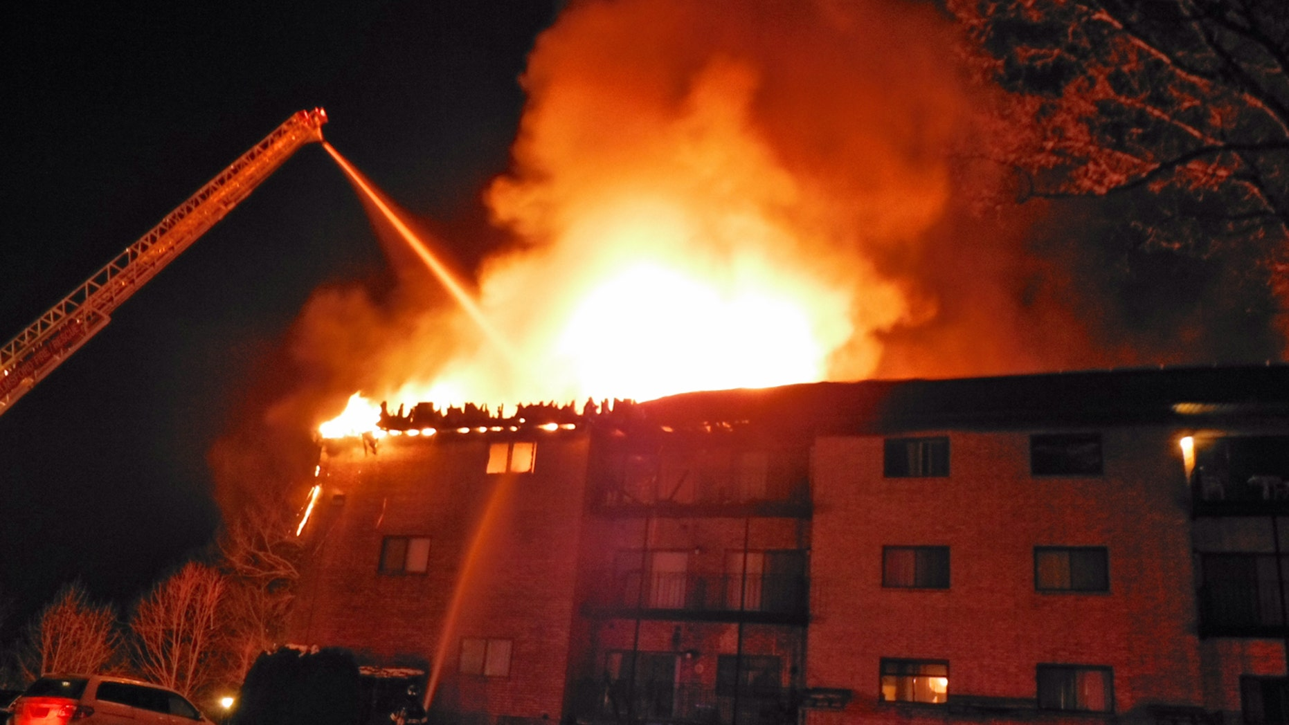 Jan. 5, 2013: Firefighters form Lowell's Ladder #3 fight a condominium fire in Chelmsford, Mass. The state fire marshal says two people died and four others were injured in the fire in northeastern Massachusetts.