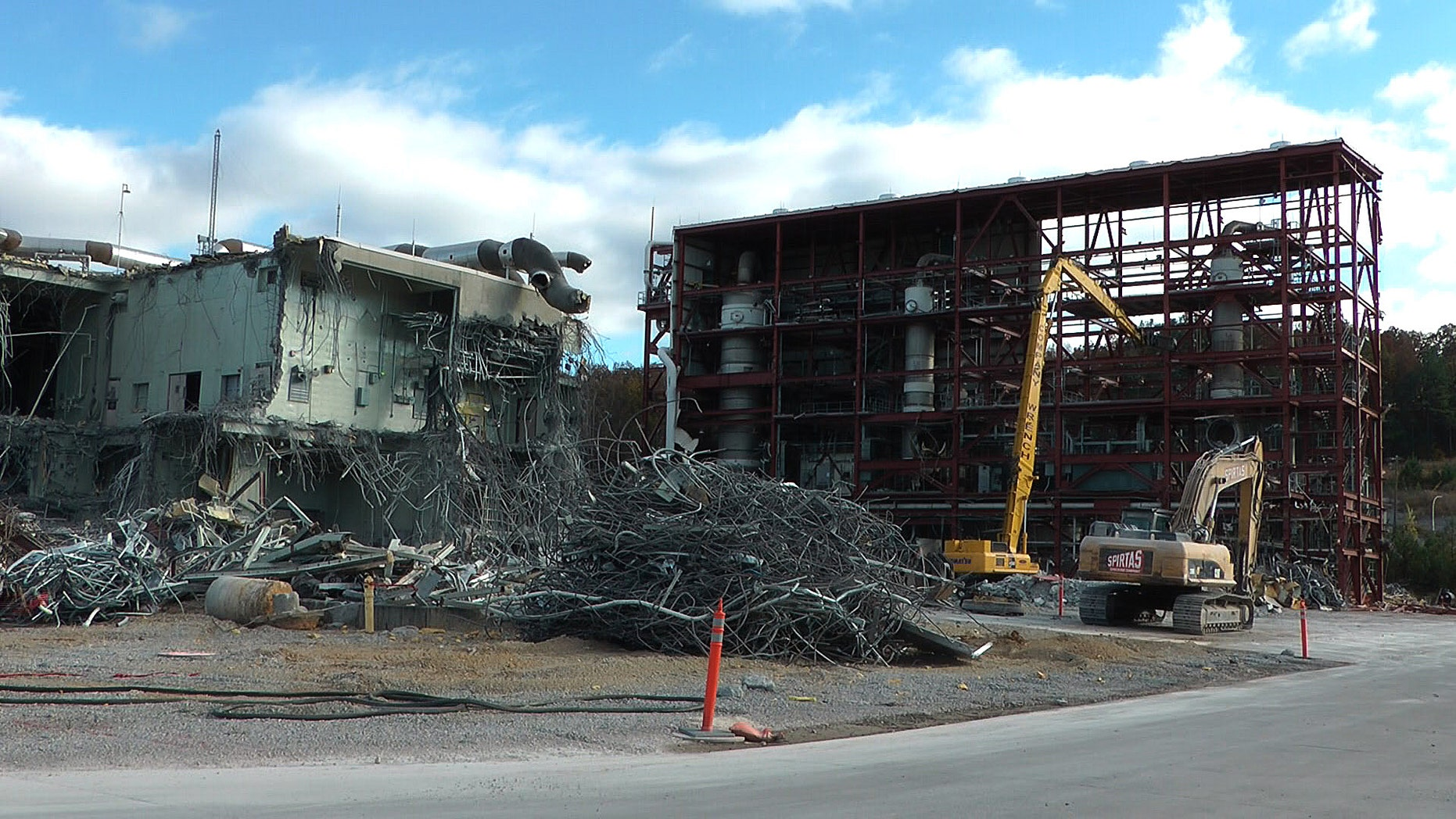 Nov. 12, 2013: In this photo workers continue the process of demolishing chemical waste incinerator at the Anniston Army Depot in Anniston, Ala.