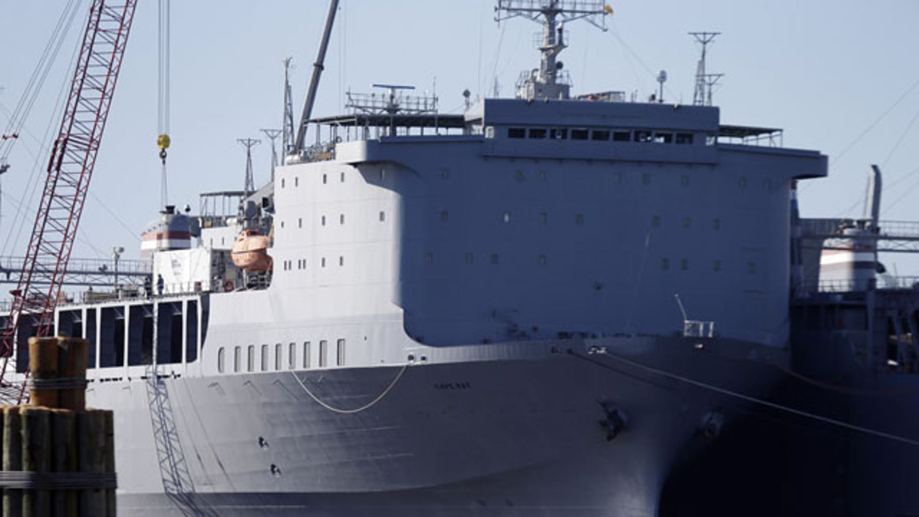 December 19, 2013: Workers unload equipment from the MV Cape Ray, part of the U.S. maritime reserve fleet in Portsmouth, Va. The U.S. ship will serve as the linchpin for the destruction of Syria's most toxic chemical weapons (AP Photo)