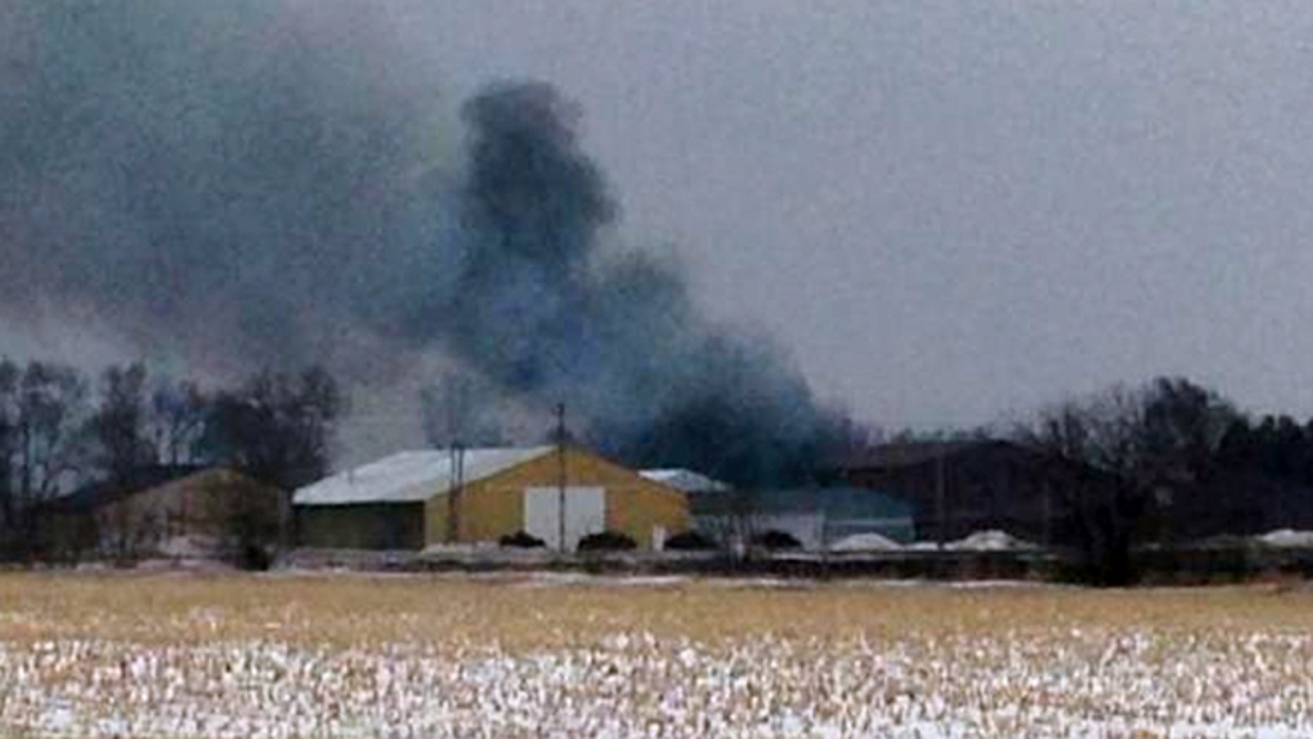 Feb. 20: Smoke rises from a fire in Northwood, Iowa as an evacuation order is in place for Northwood due to a fire at a fertilizer plant at Northwood Municipal Airport.