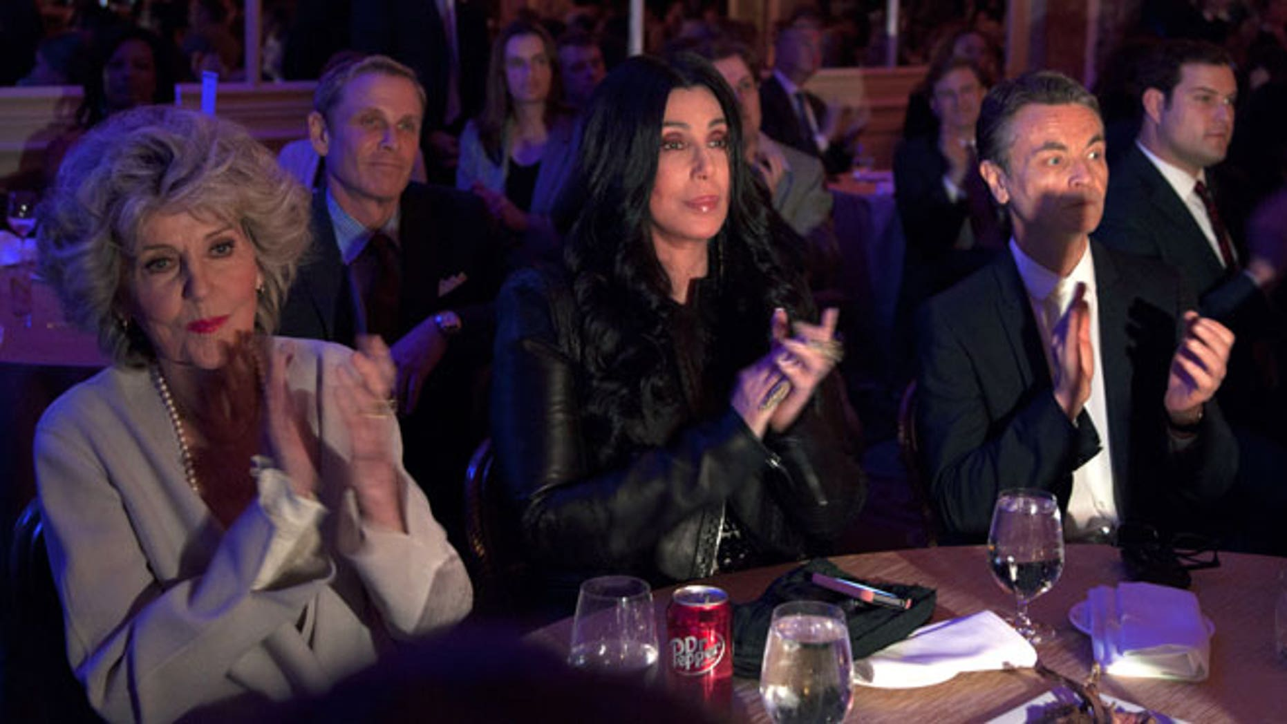 June 6, 2012: Cher looks at the stage and applauds as President Barack Obama speaks at a campaign event at the Beverly Wilshire Hotel, in Los Angeles.