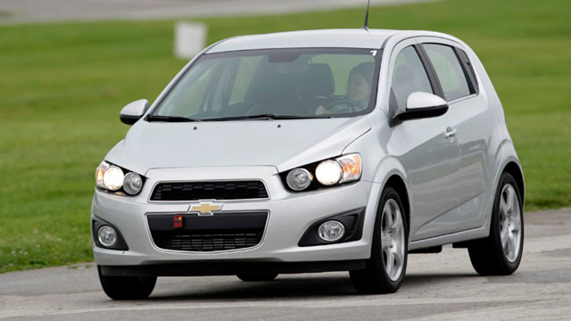 A 2012 Chevrolet Sonic hatchback is driven around the track during a media engineering drive in Indianapolis, Indiana May 27, 2011.   REUTERS/AJ Mast/Chevrolet/Handout    (UNITED STATES - Tags: TRANSPORT BUSINESS) FOR EDITORIAL USE ONLY. NOT FOR SALE FOR MARKETING OR ADVERTISING CAMPAIGNS. THIS IMAGE HAS BEEN SUPPLIED BY A THIRD PARTY. IT IS DISTRIBUTED, EXACTLY AS RECEIVED BY REUTERS, AS A SERVICE TO CLIENTS