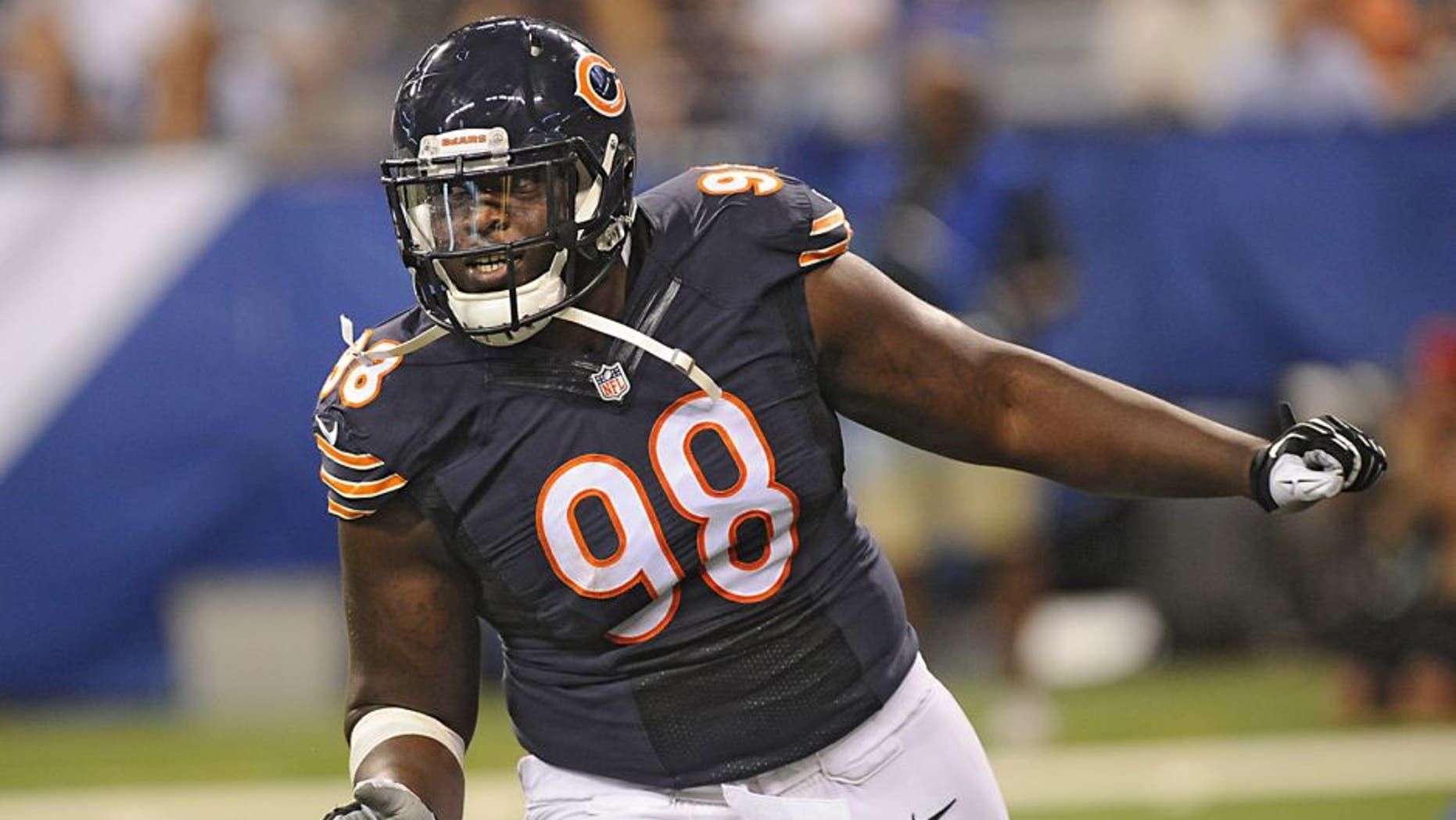 Aug 22, 2015; Indianapolis, IN, USA; Chicago Bears linebacker Brandon Dunn(98) celebrates a fumble recovery against the Indianapolis Colts during a pre season game at Lucas Oil Stadium. Mandatory Credit: Thomas J. Russo-USA TODAY Sports