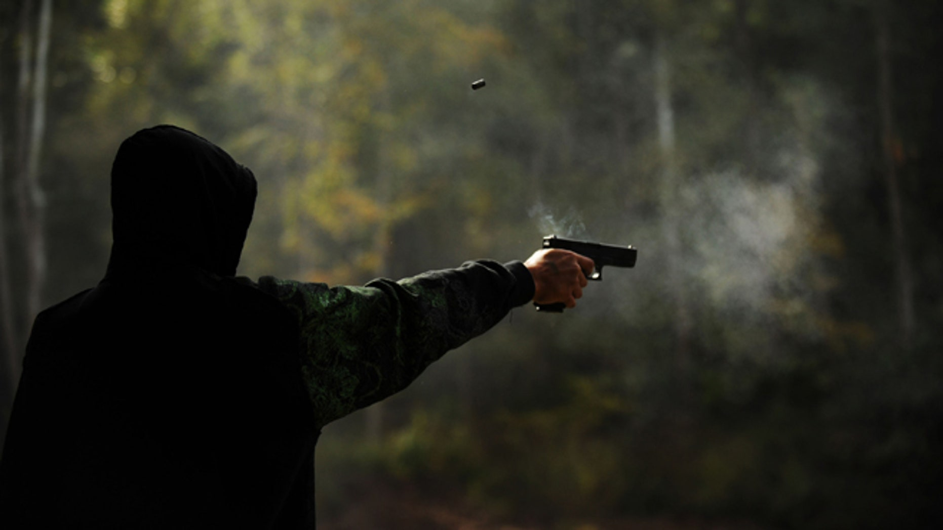 WEST POINT, KY - OCTOBER 10:  Alex Soballe, 17, of Chicago, Ill. shoots a 9mm handgun at the Knob Creek Machine Gun Shoot on October 10, 2009 in West Point, Kentucky.  The Supreme Court is currently hearing a portion of last year's Second Amendment case, District of Columbia v. Heller, that found that the amendment protects a person's right that the federal government can not abridge. (Photo by Matt McClain/Getty Images)