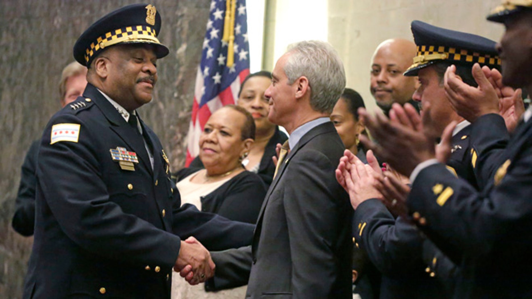 Chicago Mayor Rahm Emanuel shakes hands with Eddie Johnson on Wednesday, April 13, 2016, in Chicago.