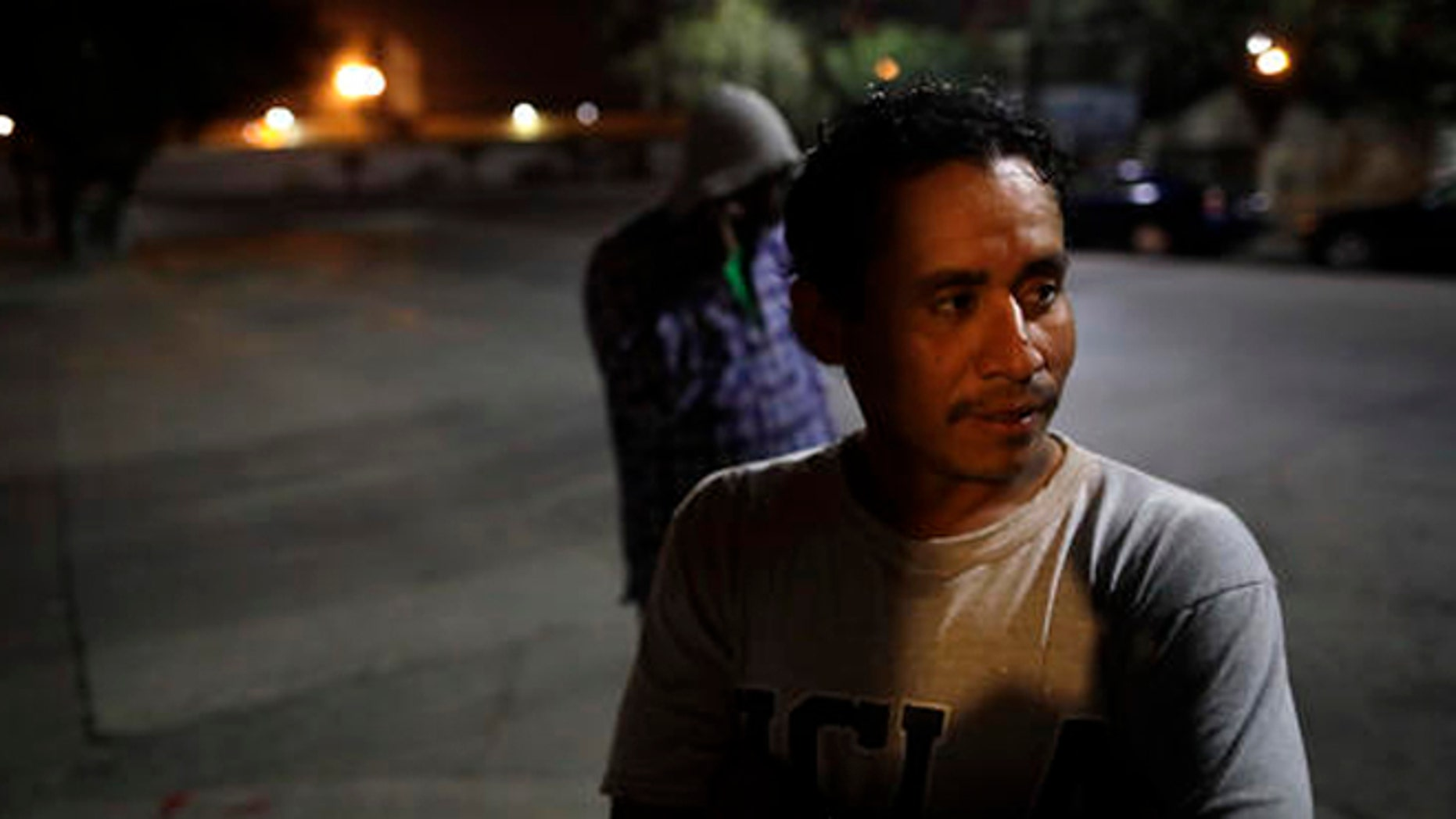 """Guatamalan Elvin Vazquez looks on from a street in front of a shelter for migrants after being deported Monday, Nov. 14, 2016, in Tijuana, Mexico. Vazquez spent more than 13 years in the United States before being deported. In an interview with CBS' """"60 Minutes"""" broadcast Sunday night, President-elect Donald Trump said he would focus on deporting people with criminal records beyond their immigration status. (AP Photo/Gregory Bull)"""