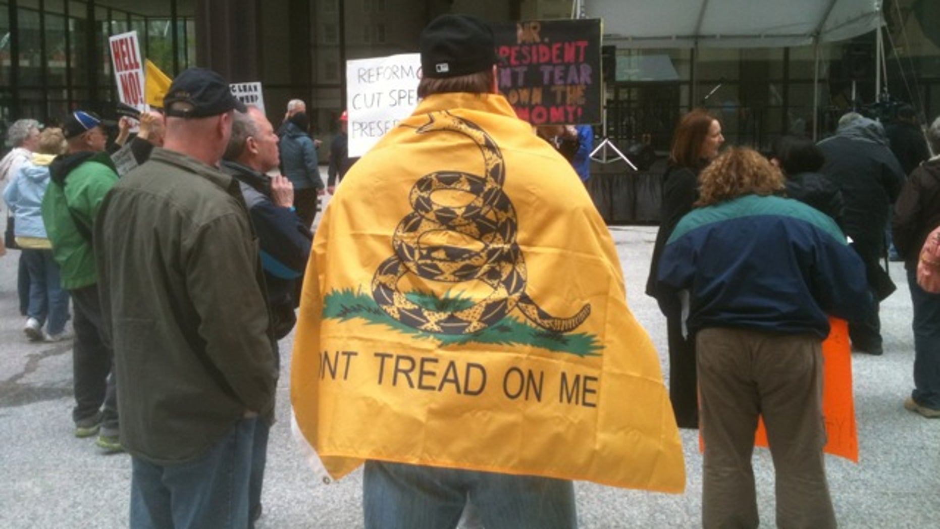 A tea party activist wears a replica of the 1775 Gadsden flag at the 2012 Tea Party Tax Day Rally in Chicago, Ill. (Michael Volpe / The Daily Caller)