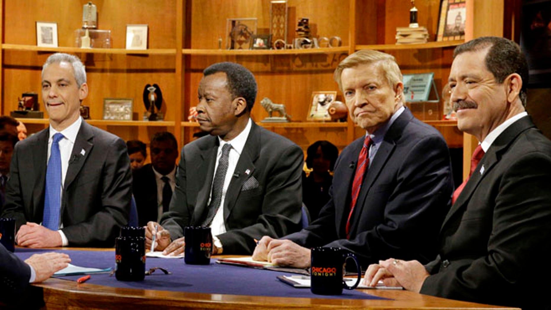 FILE: Feb. 4, 2015:  from left, Chicago Mayor Rahm Emanuel, businessman Willie Wilson, Alderman Bob Fioretti, Cook County Commissioner Jesus Garcia in Chicago, Ill.