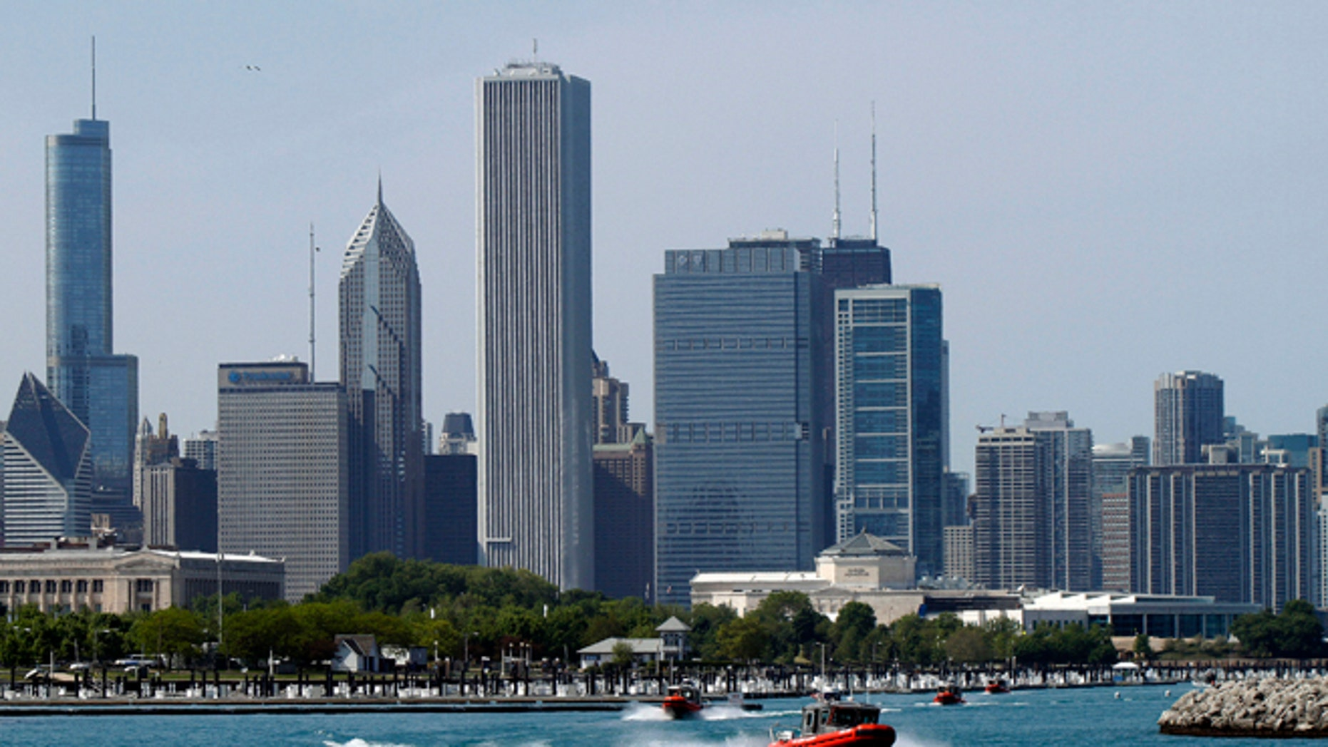 FILE: May 17, 2012: Chicago's skyline is seen as U.S. Coast Guard boats leave Burnham harbor on Lake Michigan, near McCormick Place, in Illinois.
