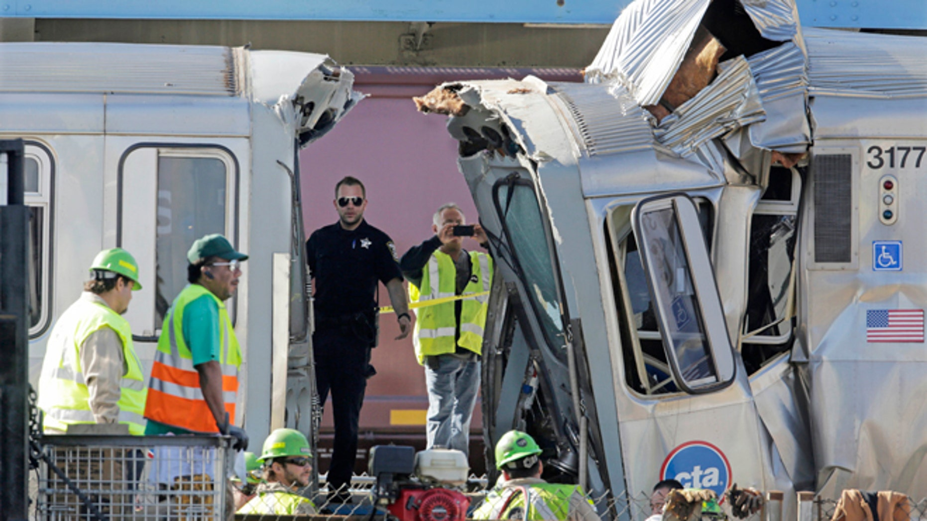 Sept. 30, 2013: Authorities inspect the wreckage of two Chicago Transit Authority trains that crashed in Forest Park, Ill.
