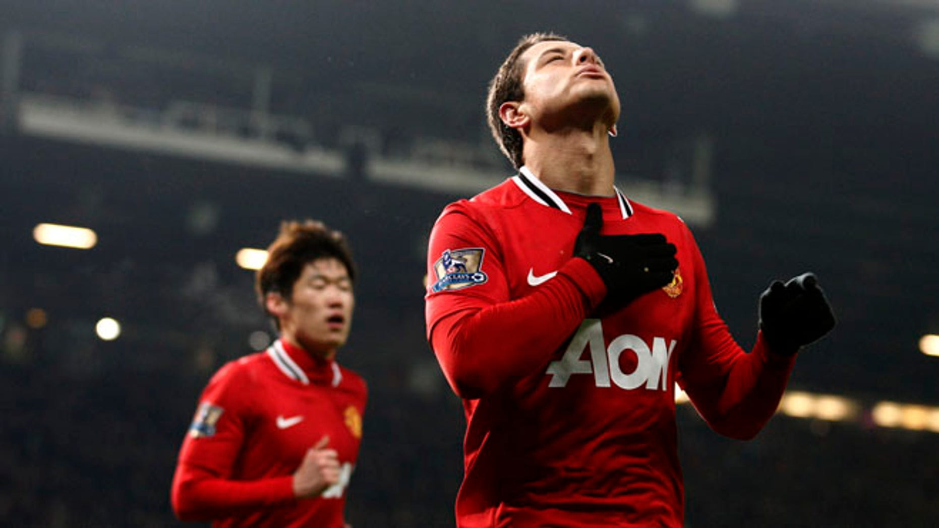Manchester United's Javier Hernandez celebrates after scoring against Stoke, Jan. 31, 2012. (AP Photo/Jon Super)