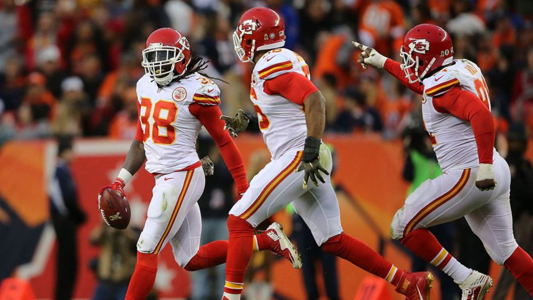 DENVER, CO - NOVEMBER 15: Ron Parker #38 of the Kansas City Chiefs celebrates his interception of a pass by Peyton Manning #18 of the Denver Broncos with Derrick Johnson #56 and Tamba Hali #91 of the Kansas City Chiefs at Sports Authority Field at Mile High on November 15, 2015 in Denver, Colorado. The Chiefs defeated the Broncos 29-13. (Photo by Doug Pensinger/Getty Images)