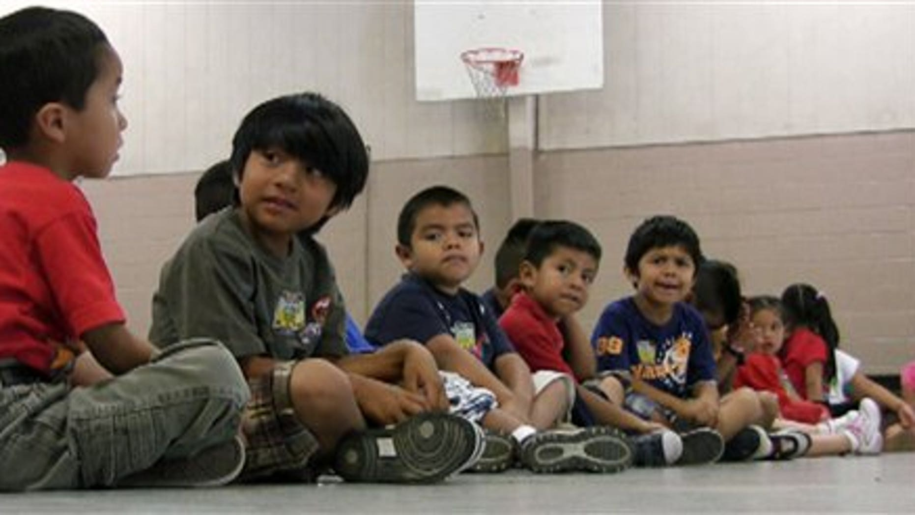 August 17: Students sit in the gym at Crossville Elmentary School in Crossville, Alabama. Despite being in an almost all-white town, the school's enrollment is about 65 percent Hispanic. Both English- and Spanish-speaking residents say they are awaiting the outcome of a federal court hearing on Alabama's new law cracking down on illegal immigration.
