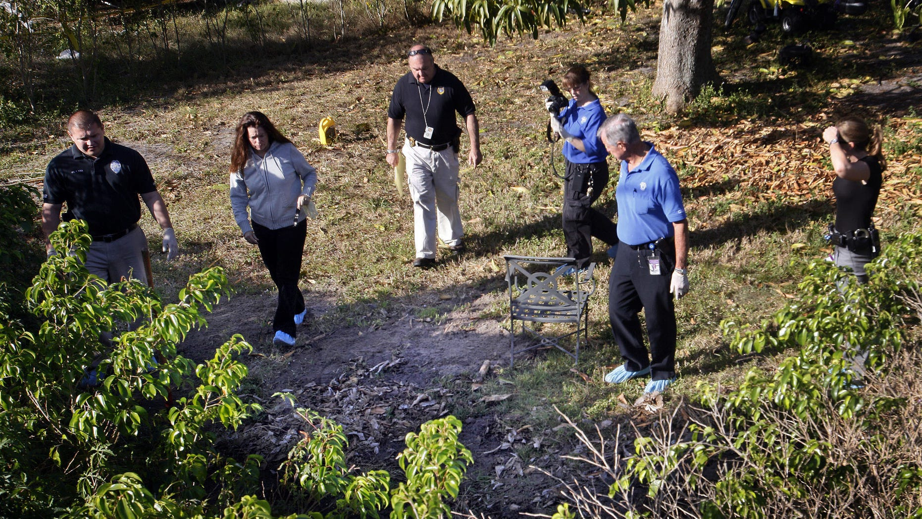 March 4: Delray Beach investigators gather in the backyard of the home of Clem Beauchamp in Delray Beach, Fla. Investigators were seen digging in a corner of Beauchamp's yard after he became a suspect in the death of his two children, found in a canal, and their mother, found in a landfill.